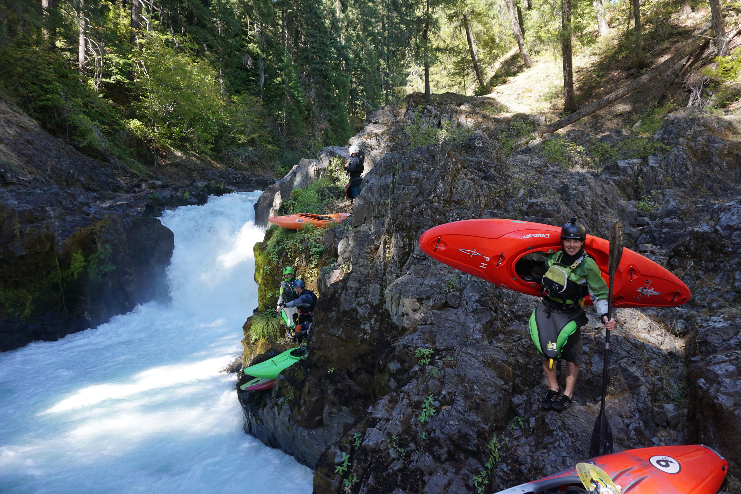 Portaging a hazardous drop at Therapy Falls Nature Bridge Section of the Rogue River Oregon. Photo courtesy of Adam Edwards.