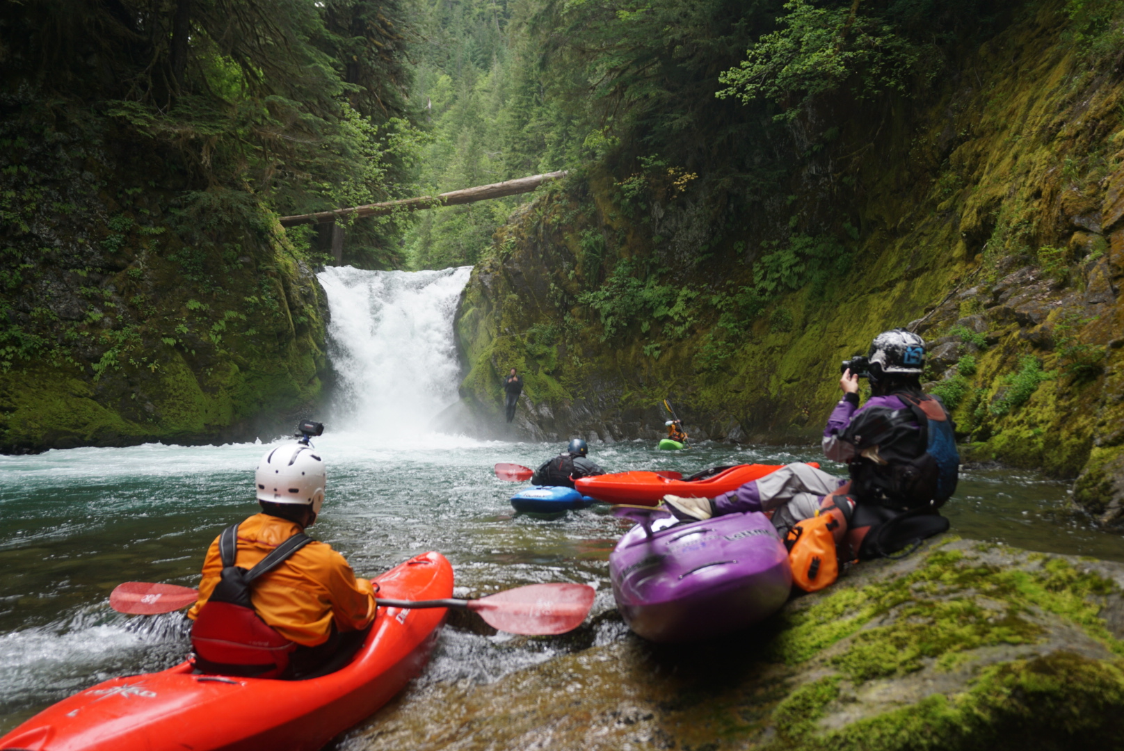 A paddler portages an unnamed falls on Yellow Jacket creek in Washington. The falls lands on a shelf makingh the line between successful run and serious injury very thin -photo by Adam Edwards