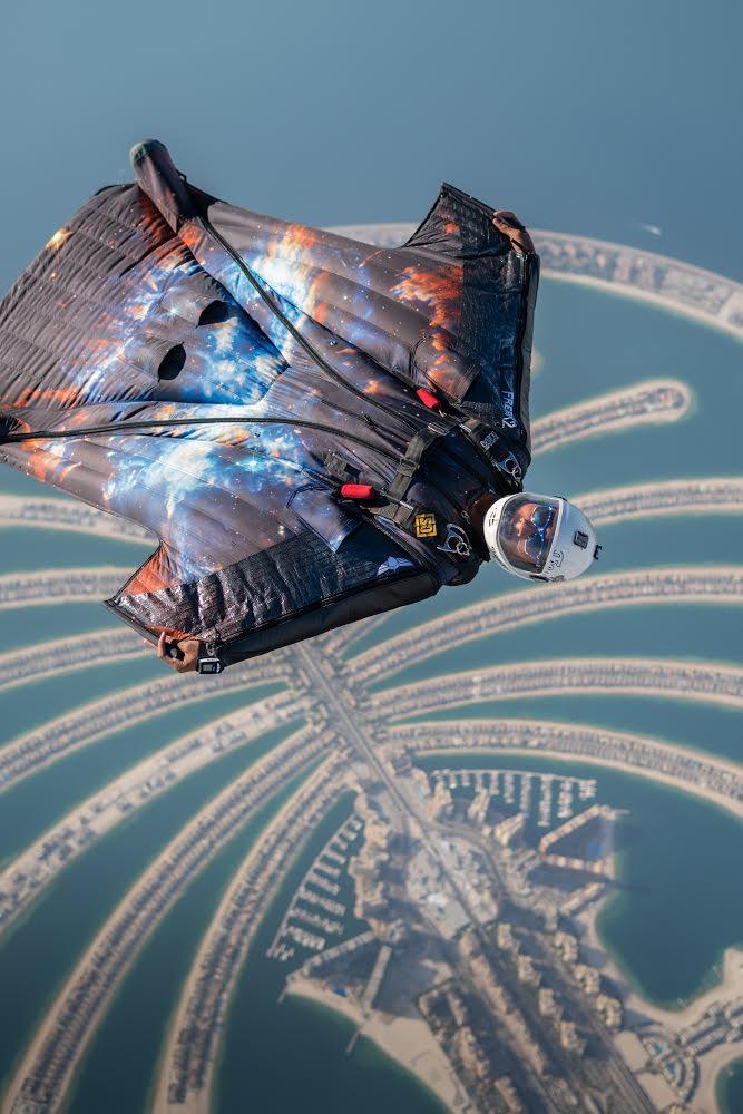 Skydiver Brandon Johnson wingsuiting over the Palm in Dubai (Photo credit: Nicholas Scalabrino)