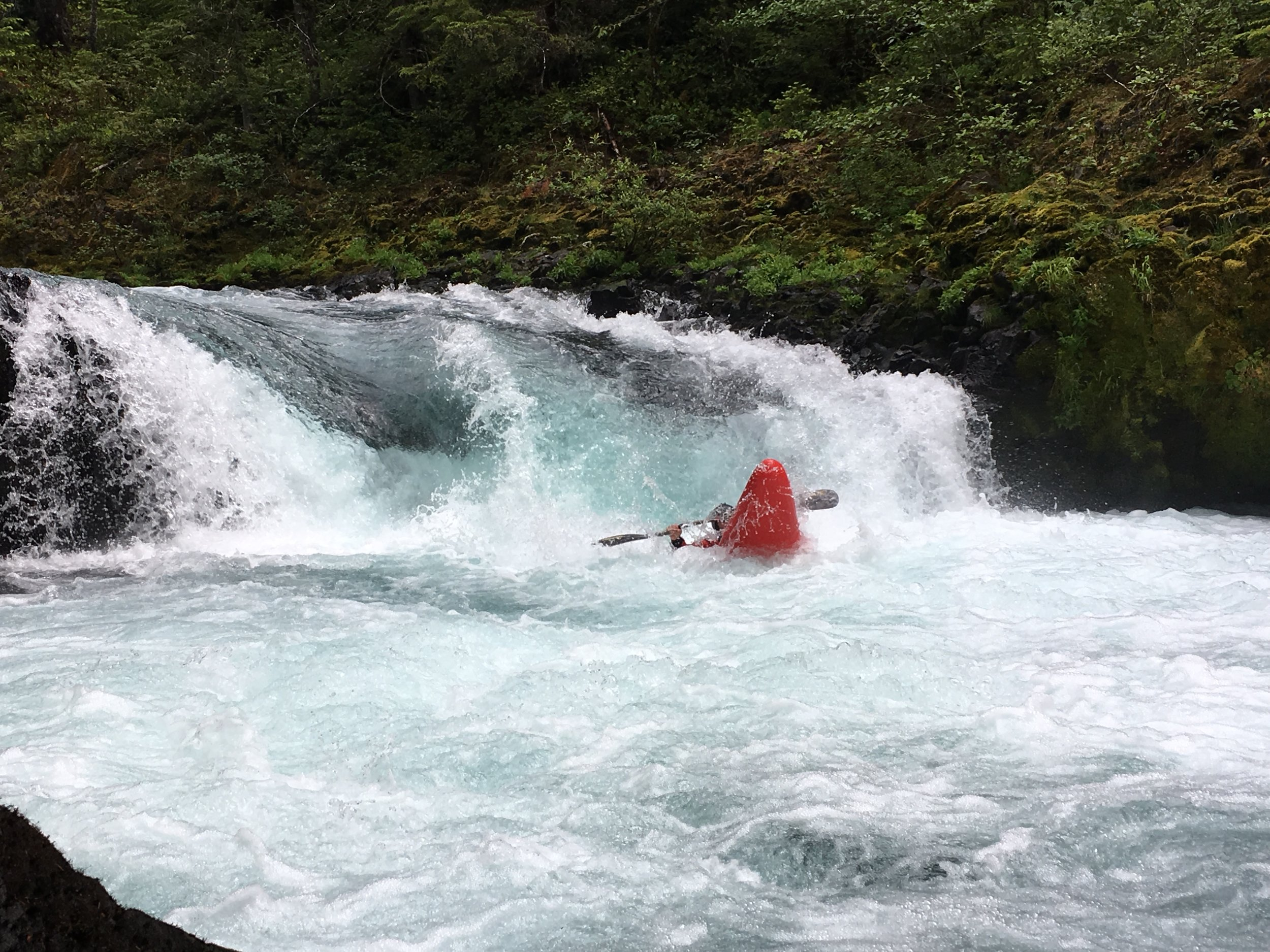 A paddler about to resurface after running Sacrilege at lower flow (Photo courtesy of Adam Edwards).