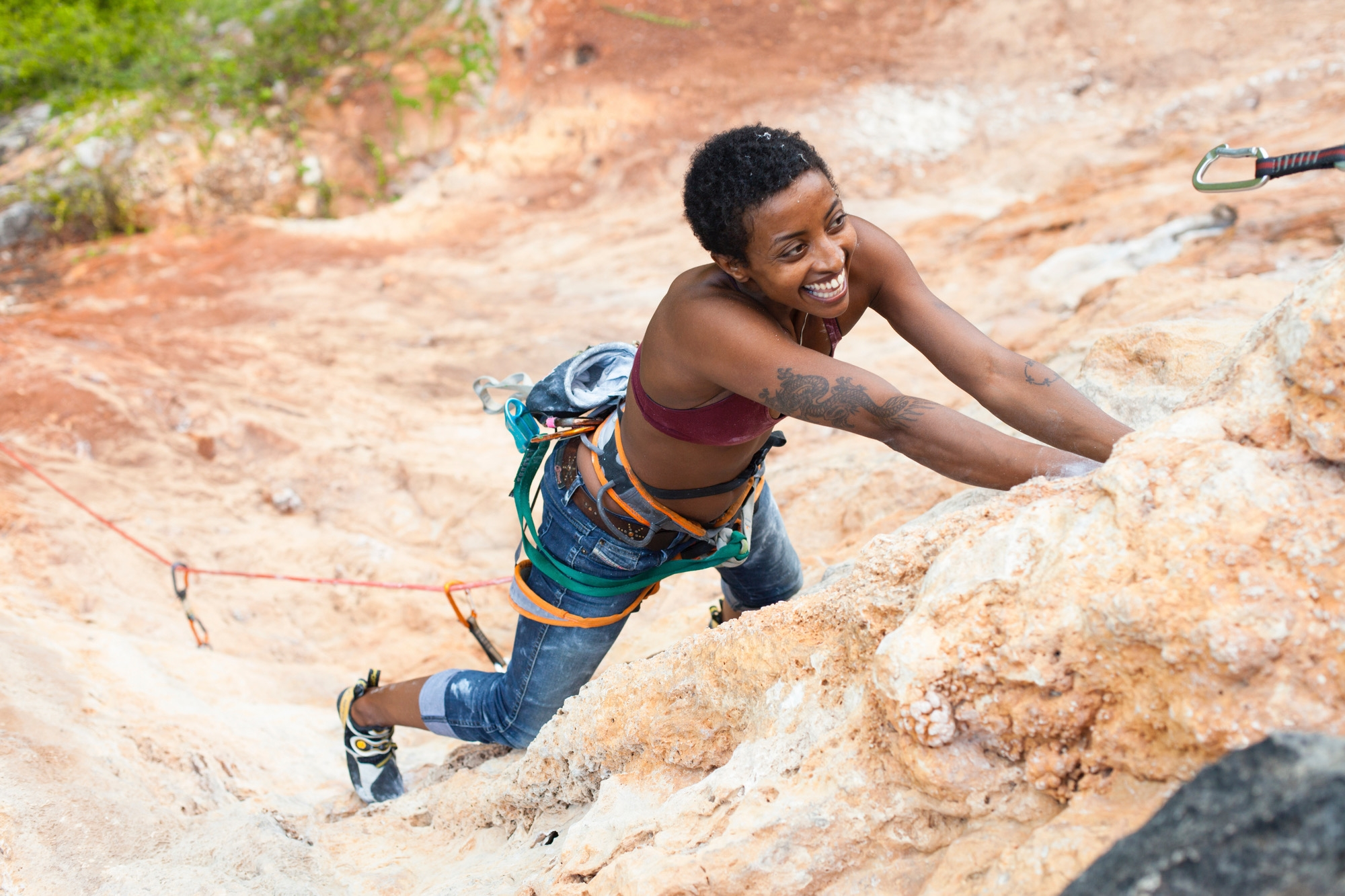 Abby Dione climbs Obstinada (5.11) in San German, Puerto Rico.