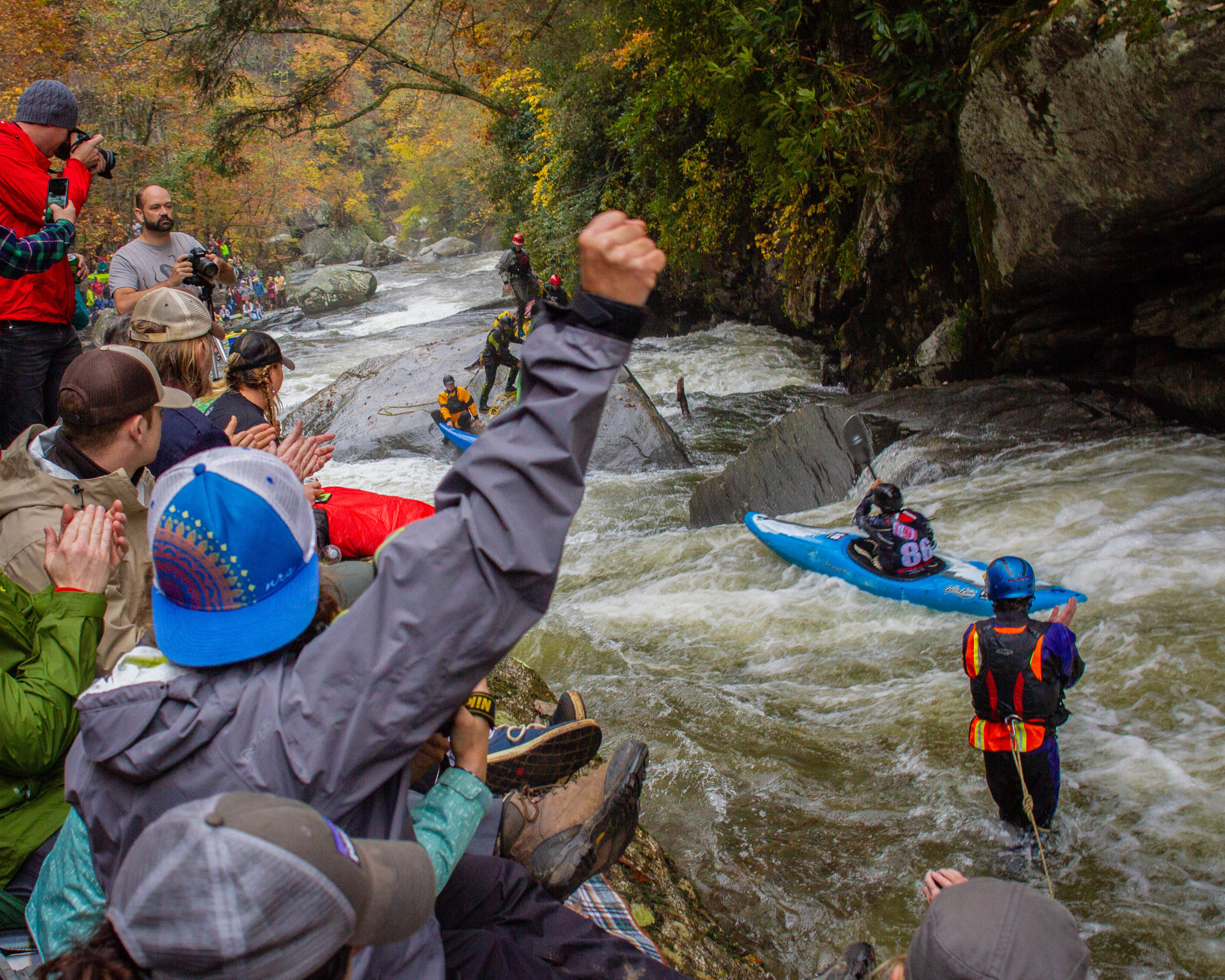 Green Race spectators and safety cheer Rashid Clifton on as he paddles the last difficult sections before the finish. Saluda, North Carolina (Photo credit: Joey Redmond).