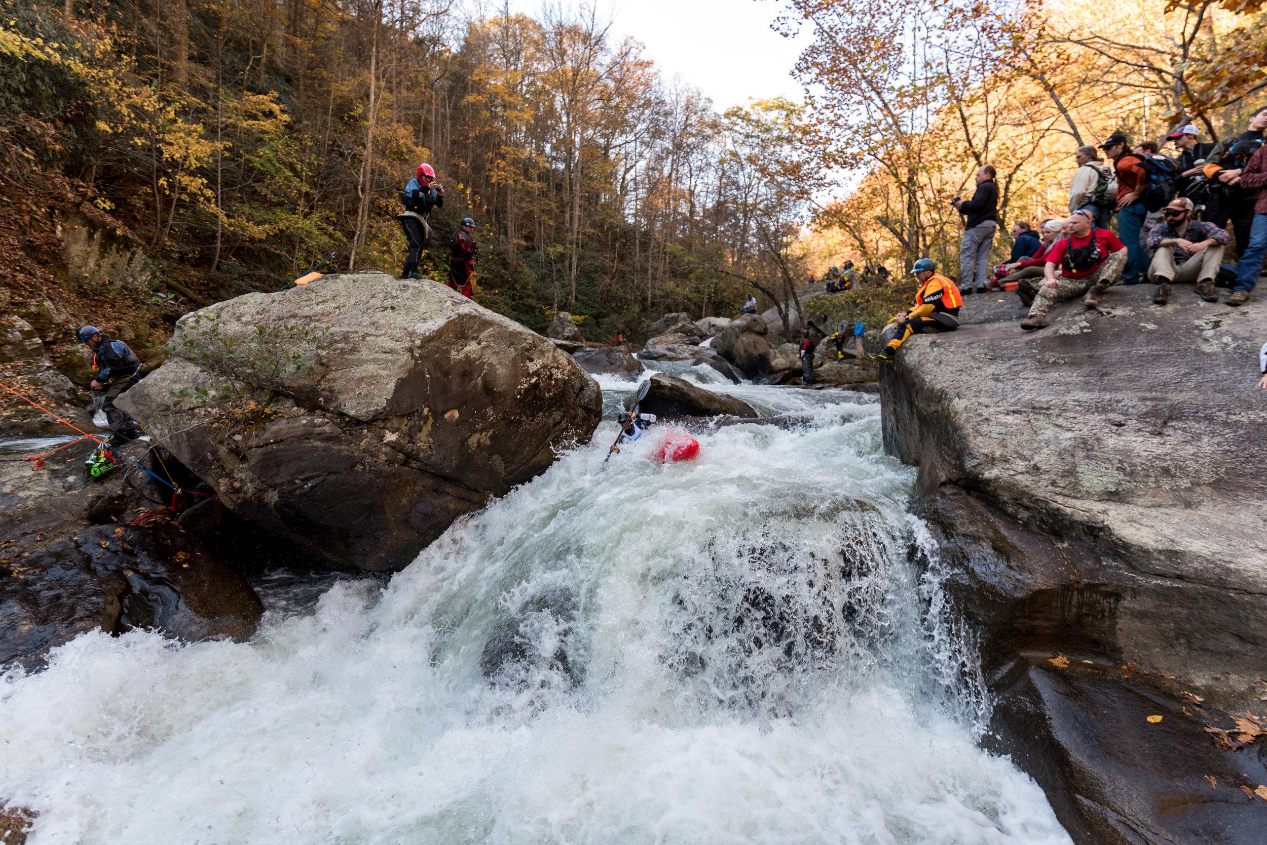 Rashid Clifton racing through a crux rapid on the Green River Narrows near Saluda, North Carolina (Photo credit: Chad Blotner)
