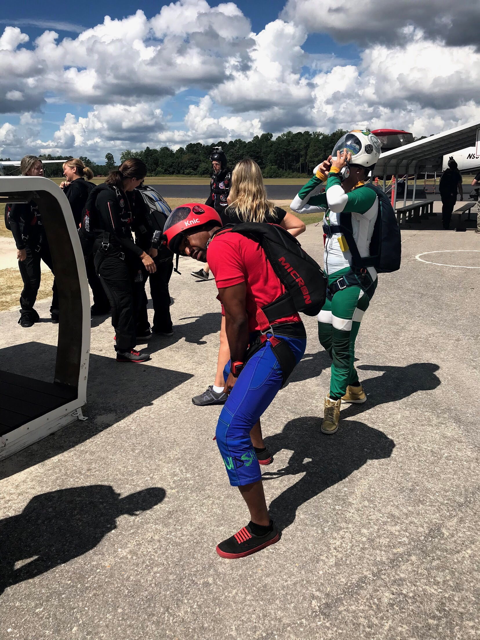 Nick adjusts the straps on his parachute rig prior to boarding the jump plane in North Carolina.  Photo credit: Danielle Williams