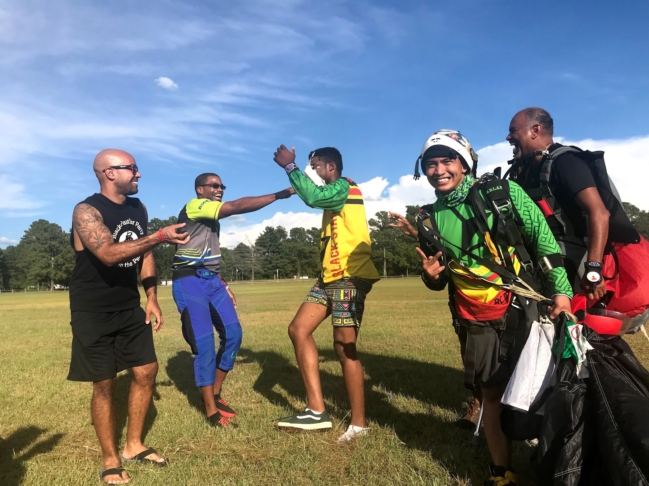 Nick (2nd from left) pies a jumper; according to skydiving tradition, jumpers are pied on the occasion of their 100th, 1,000th and 10,000th skydive!  Photo courtesy of Danielle Williams