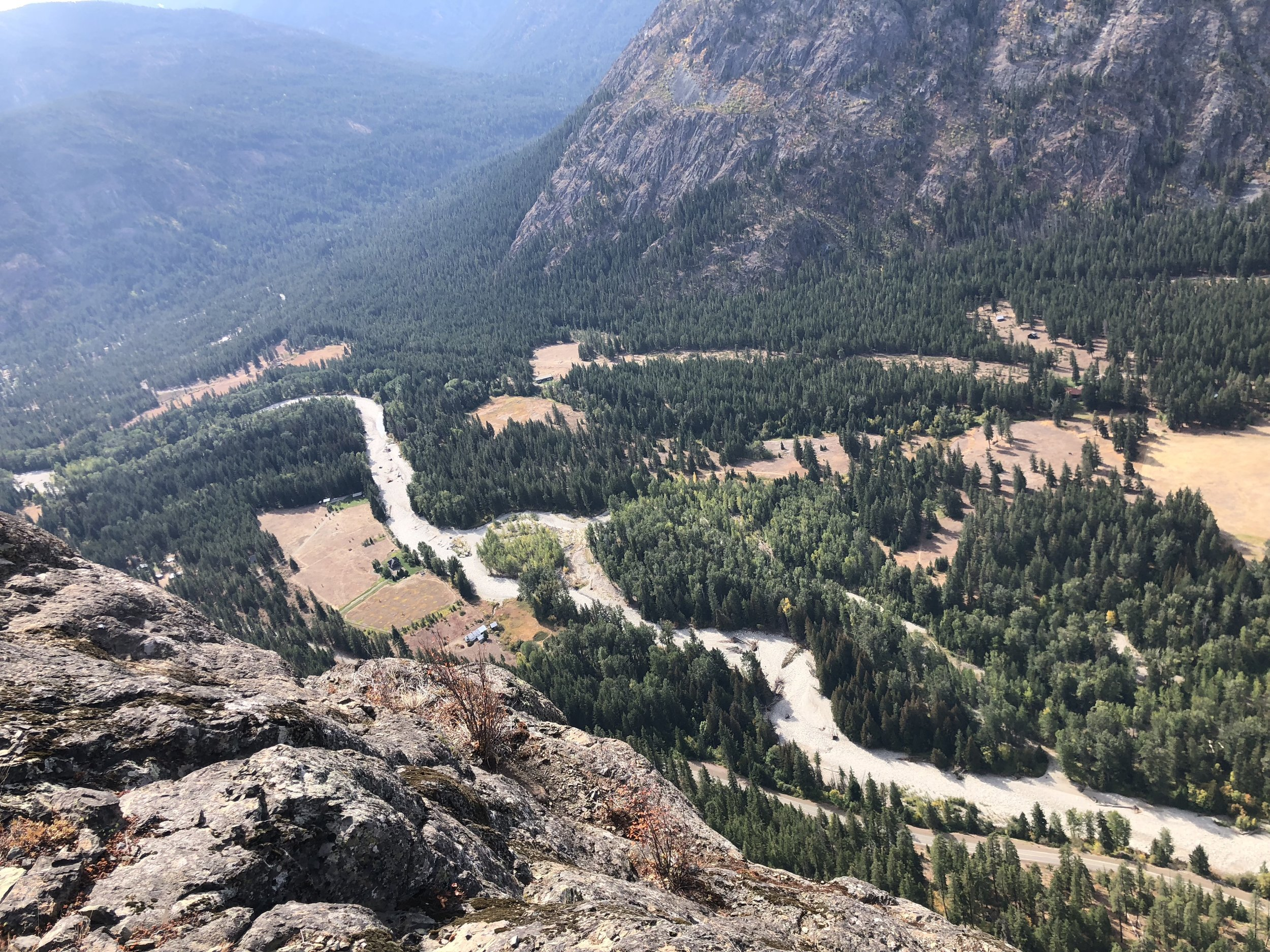 The view looking down at the valley floor as trees and cars get smaller and smaller.