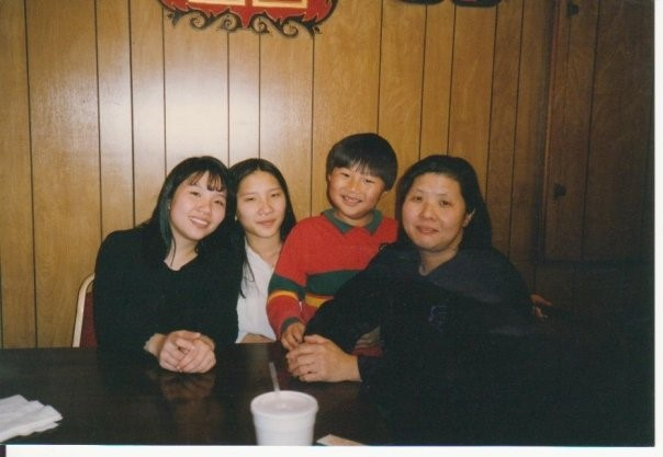 (left to right) My sister, me (in high school), my sister's son, and my mom at our Chinese restaurant in Columbia, SC.  Photo courtesy of Wai Yi Ng.