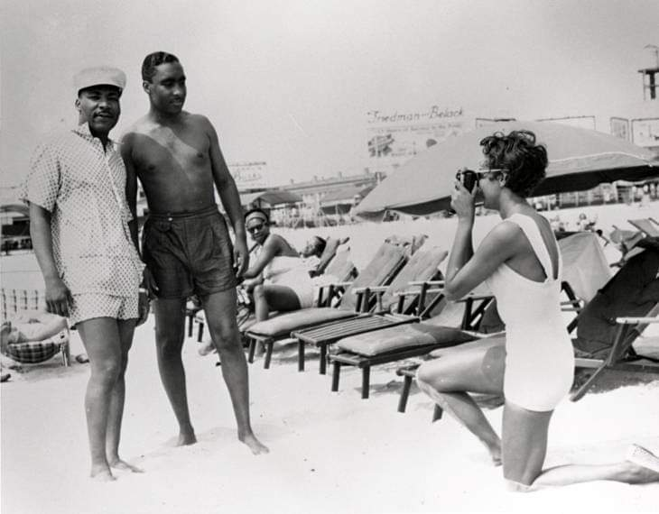 """Dr. Martin Luther King Jr. (left) poses for a photo at the segregated Missouri Avenue Beach in Atlantic City known as """"Chicken Bone Beach.""""  Photo courtesy of the Vintage African American Photography Facebook Group."""