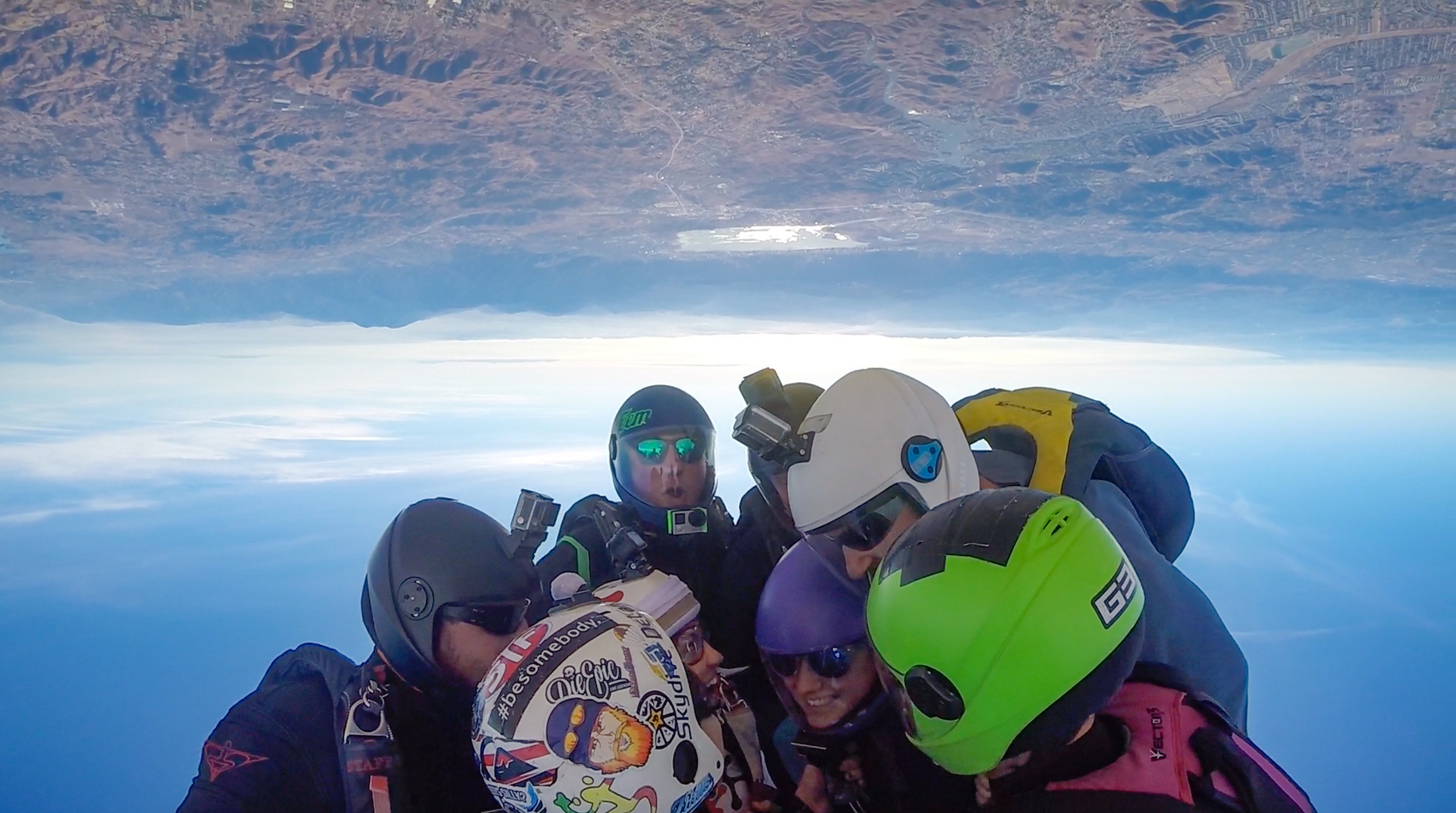 Upside down team huddle at 12,500 ft in the air.