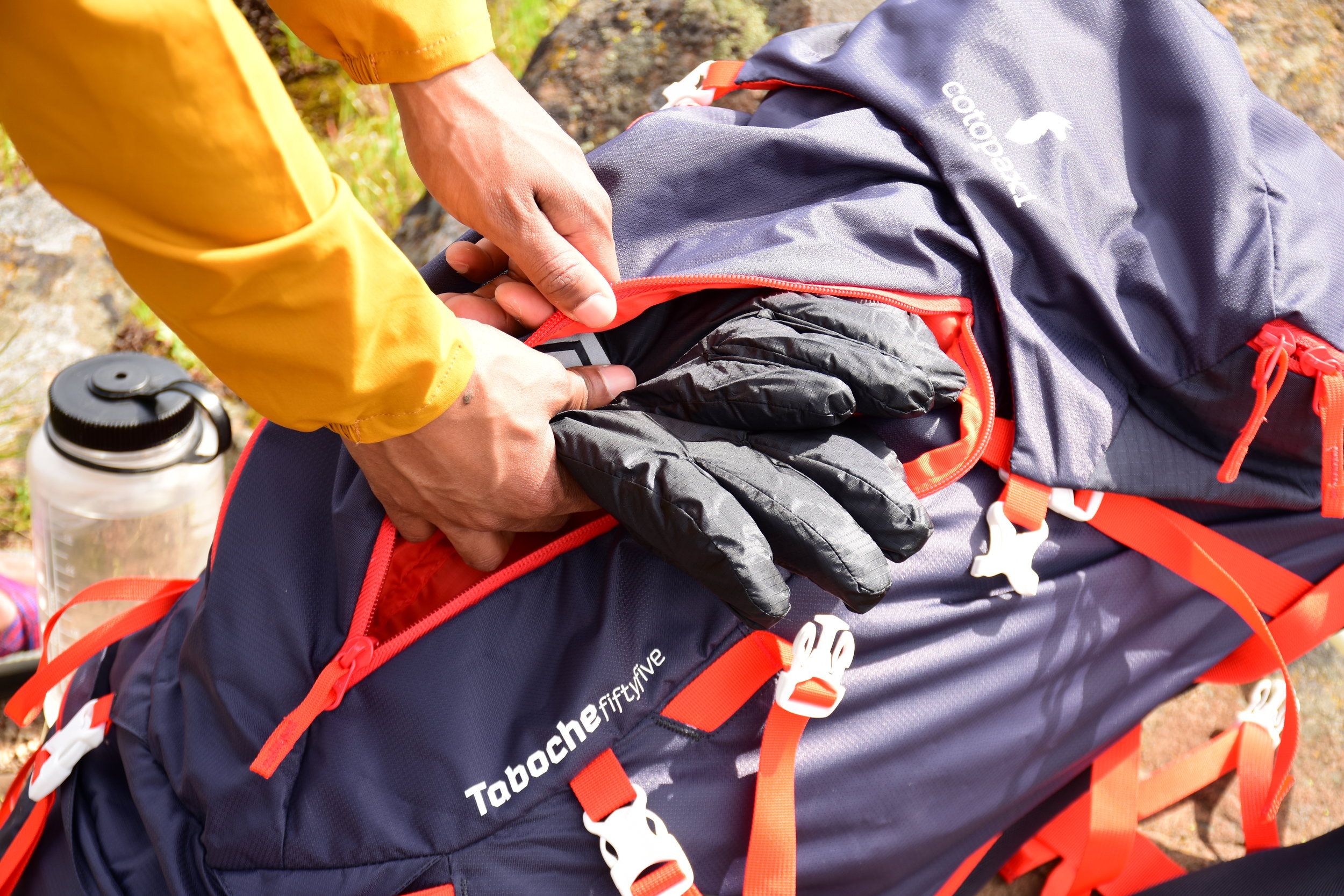Never upend your entire pack in search of gloves again! Just store them here in one of the Taboche's easily accessible exterior storage pockets.  Photo courtesy of Nathan Kaul