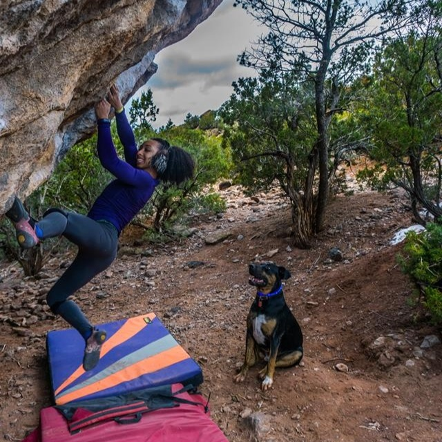 Dr. Favia Dubyk enjoys bouldering with her crag dog Hans.  Photo courtesy of Favia Dubyk