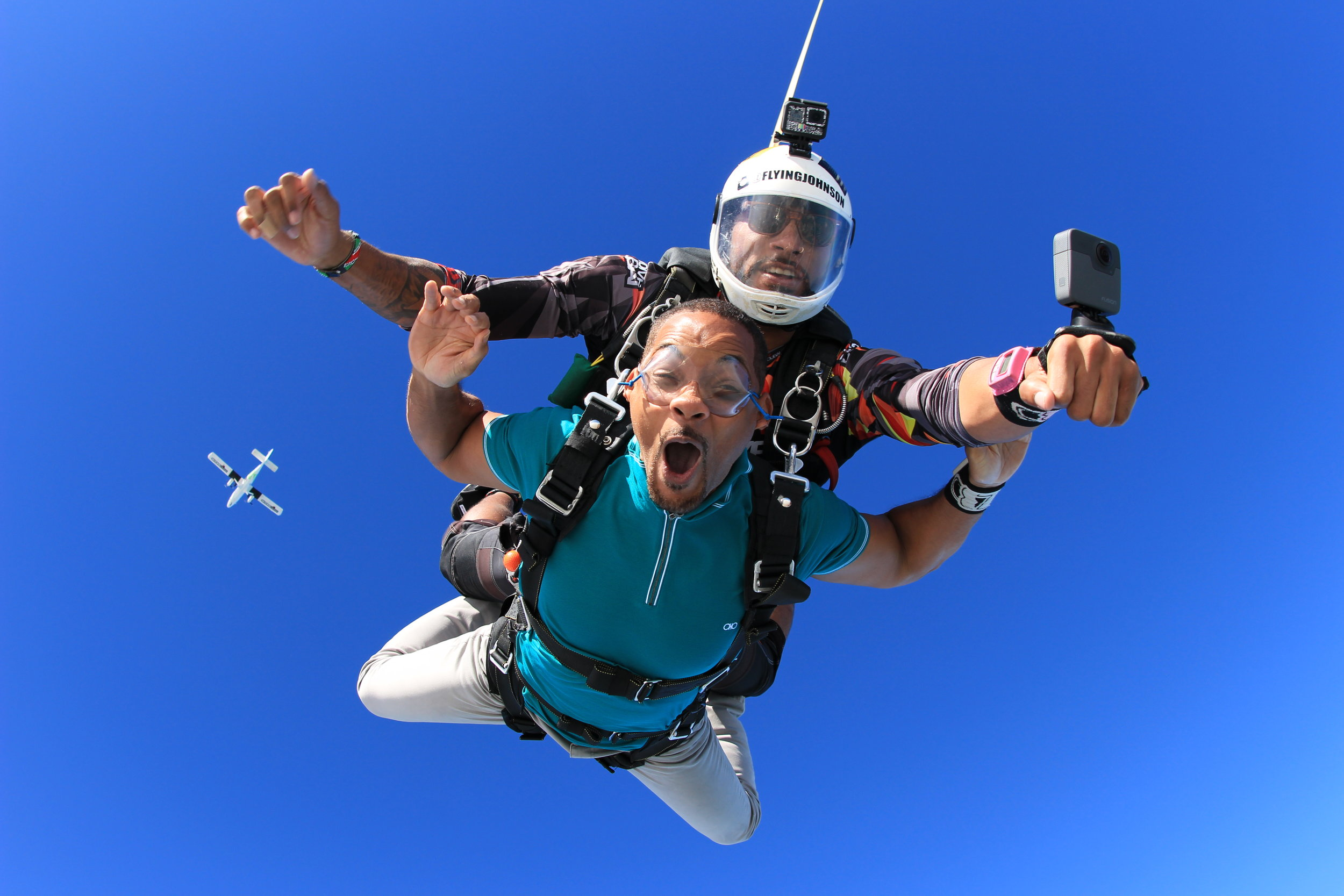 Tandem instructor  Brandon Johnson  takes actor Will Smith on a skydive in Dubai.  Photo courtesy of Rodney Crossman