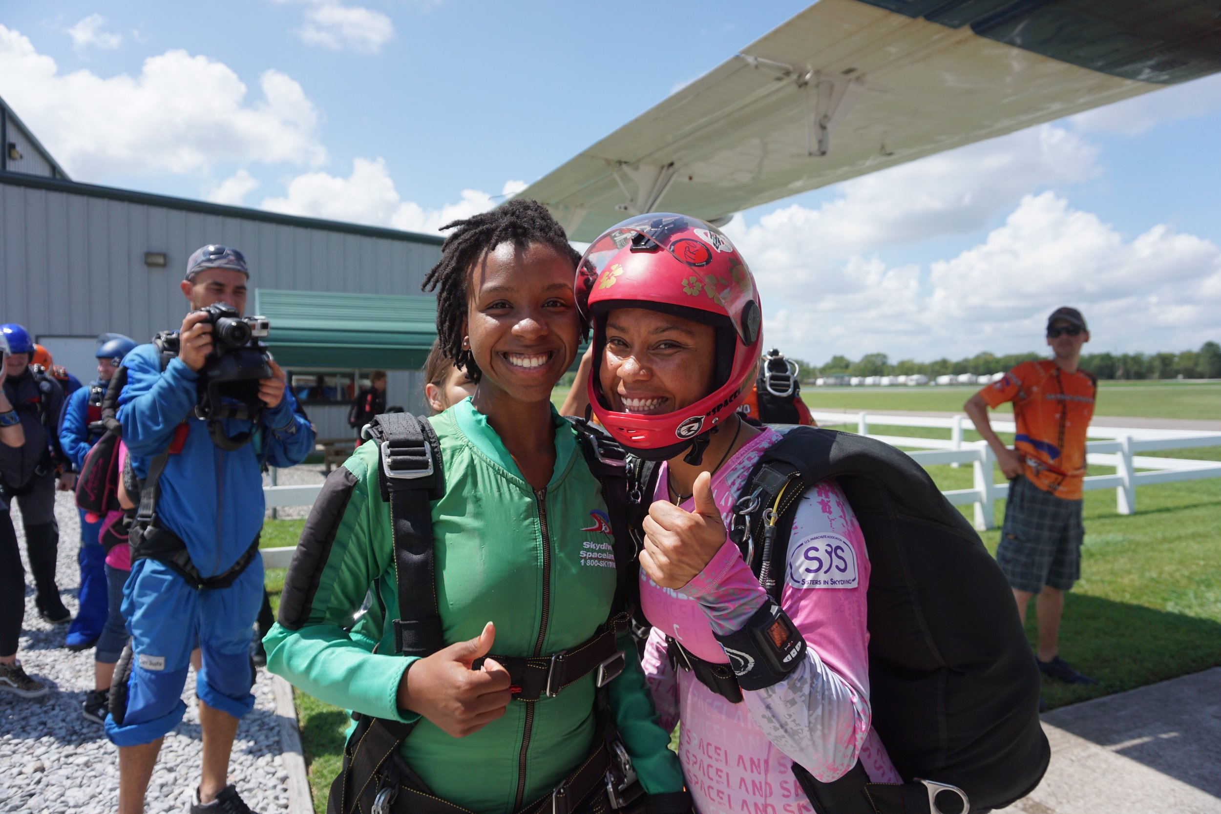 Erendira Sanchez González  (right) poses for a photo with her tandem student at Skydive Spaceland in Houston, TX. Erendira is the only active black woman tandem instructor in the United States. She is also the only black or Latinx female tandem examiner in the U.S.  Photo courtesy of    Woodbury Roland