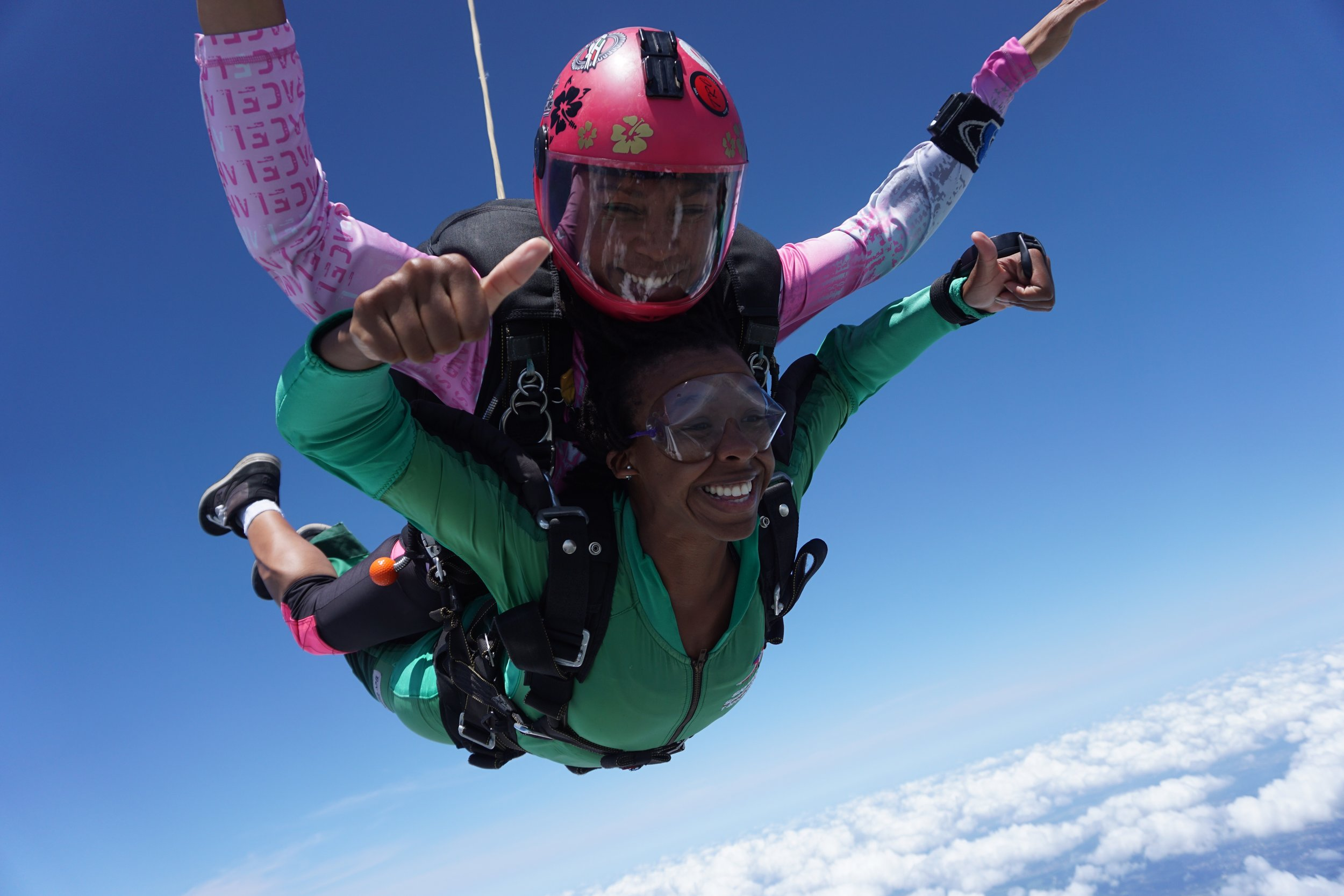 Afro-Mexican tandem instructor  Erendira Sanchez González  (pink helmet) started skydiving when she was 15-years-old. She comes from a family of skydivers—her father has over 22,000 jumps.  Photo courtesy of    Woodbury Roland