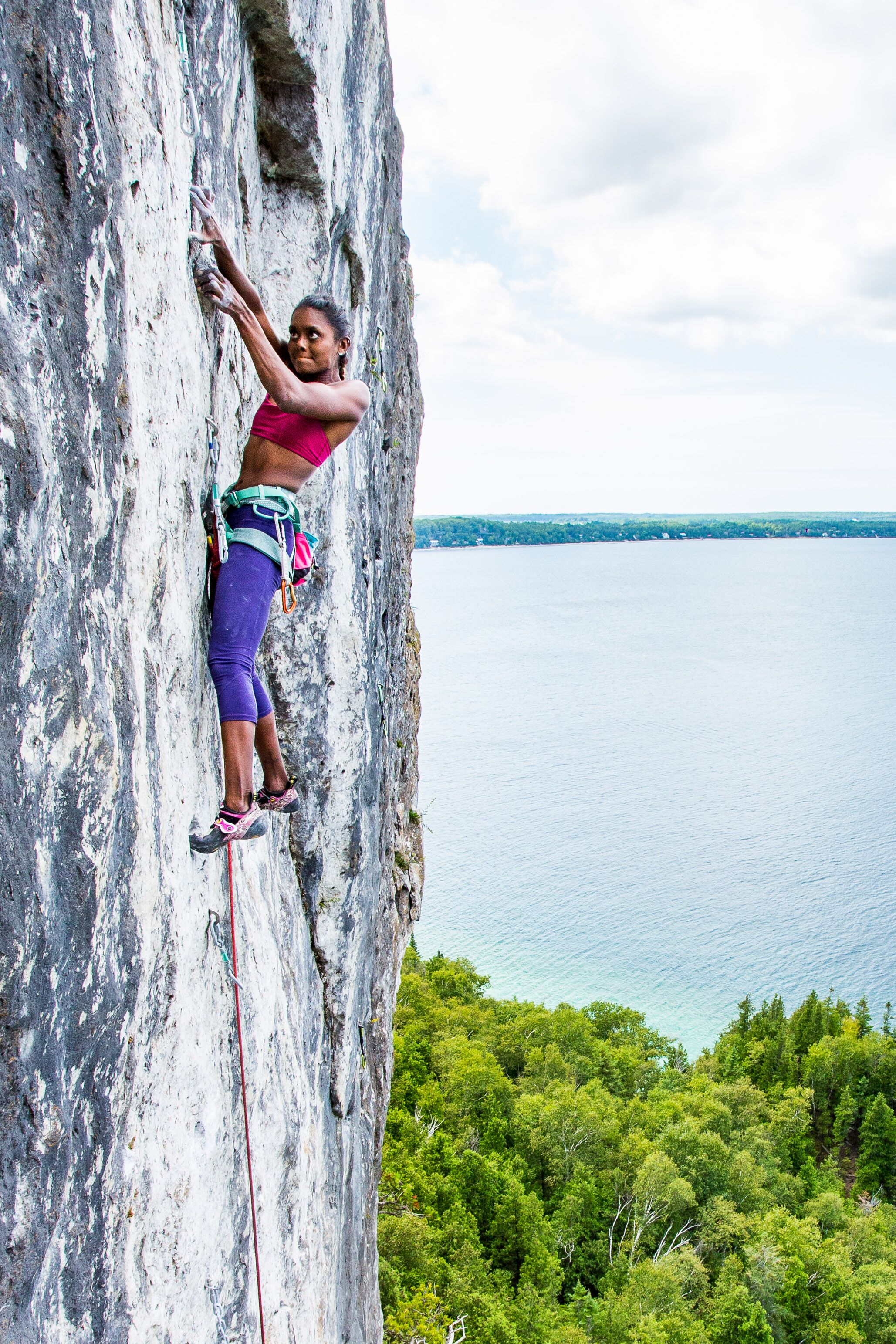 Sabrina climbs her 5.14a project, Titan, in Bruce Peninsula National Park, Ontario, Canada.  Photo courtesy of Shawn Robertson