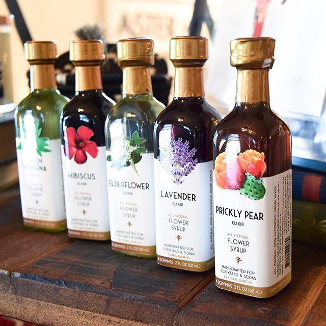 We're hanging onto the final days of summer and spending the day relaxing with a drink in hand 🍹 These floral syrups from OH-based company @drinkyourflowers are perfect for mixing up your fave cocktails, sodas and teas 🌺 The shop is open from 12-5p today, so swing by and take a look at these delish elixirs! • Floral Elixir Co. started from an idea to create cocktails and sodas with flowers in late 2008 after founder Nora Egger's return to the US after working in Europe for a decade. Originally from Austria, Nora has spent her life living between Europe and the US, and while working in Europe, she traveled extensively and became fascinated in the role flowers and botanicals played in drink and food cultures.🌺 • They call their flower syrups elixirs, as they're more potent than regular pure cane sugar syrups and made from real flowers and botanicals.🌺