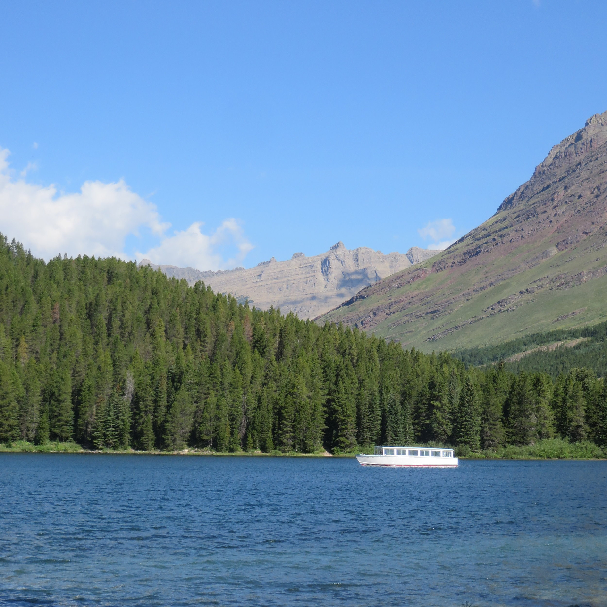 Chief Two Guns crossing Swiftcurrent Lake in Many Glacier.