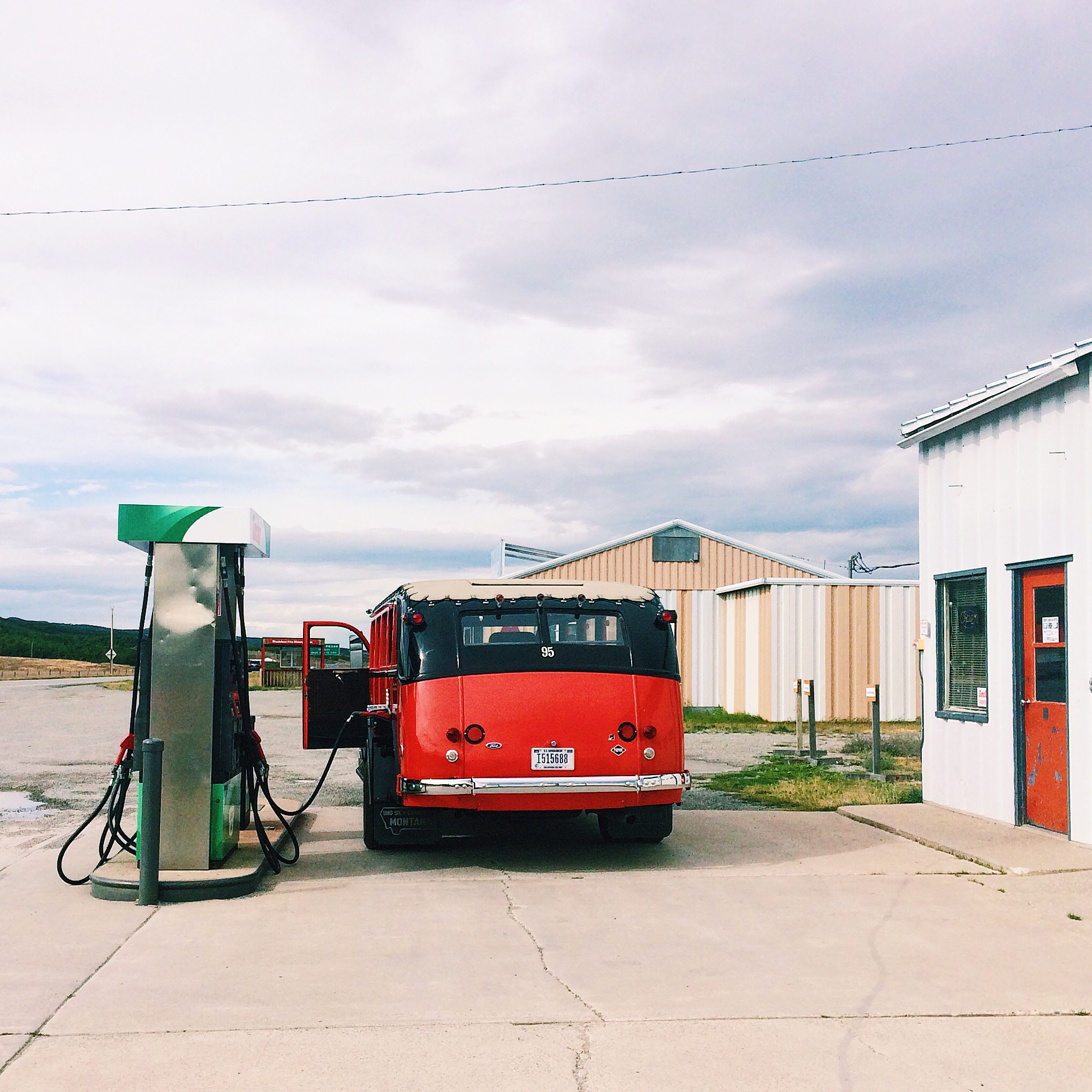 Red Jammer gassing up at Thronson's General Store in Babb, Montana