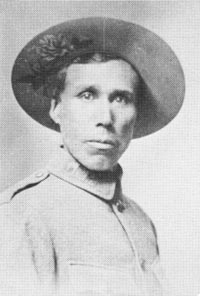 Joe Cosley portrait featuring his modified Glacier Park Ranger Uniform, 1910. I don't think all the rangers painted red roses on the undersides of their hats! NPS Archive Photo.
