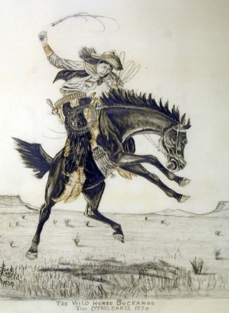 """Cosley shows off his artistic side with one of many drawings featuring """"Bucking Broncs."""" Tom O'Phileard was a cowboy buddy described by Cosley as one of the three """"slickest horsemen in the Yellow Stone country"""" along with Joe himself, of course."""