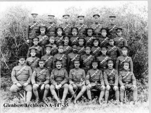The Cardston Mounted Rifles; Joe is in the center of the second row. Glenbow Archives.