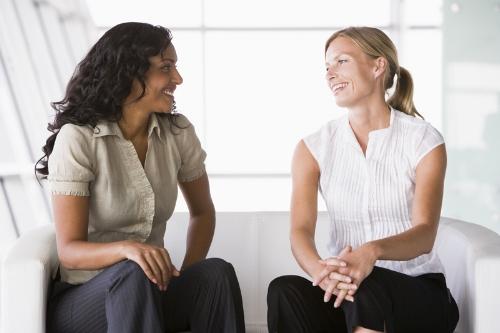 2-women-sat-talking-on-a-couch.jpg