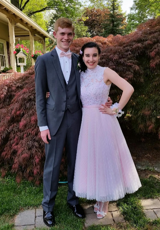 Ava looking fabulous in red and pink for prom.