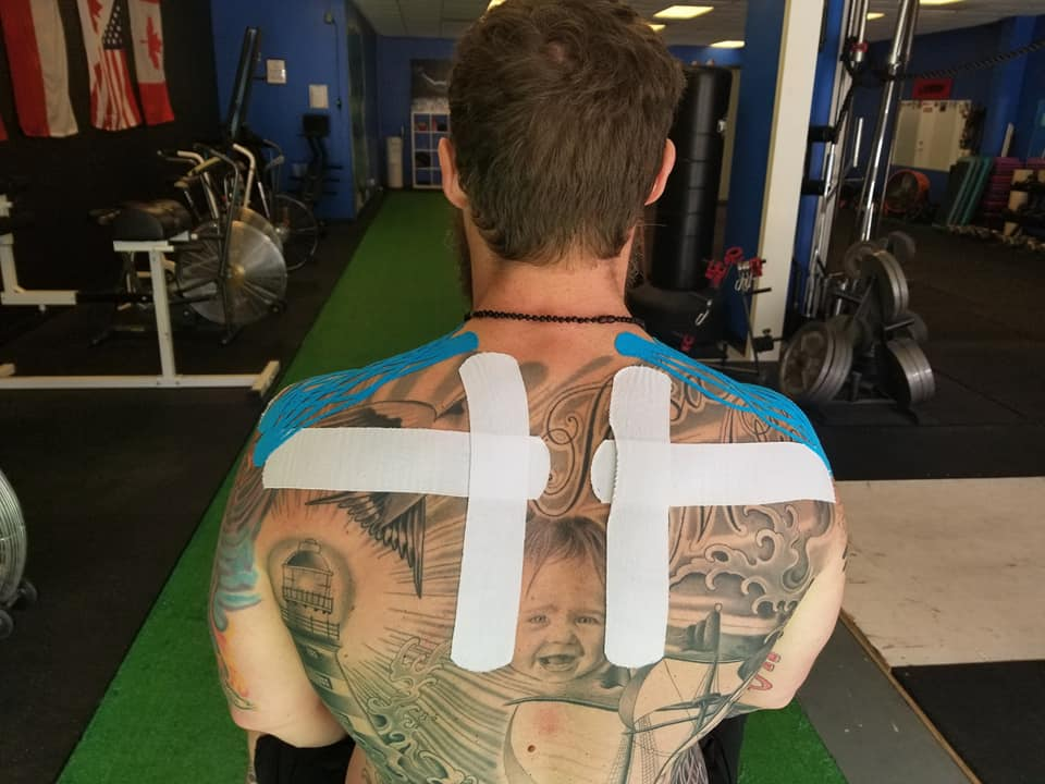 Man's back with tape from Innovative Health and Performance kinesiotaping