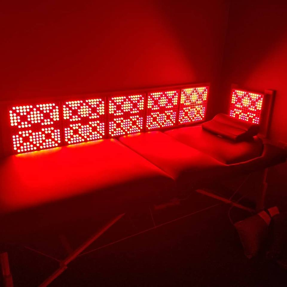 Bed inside the Innovative Health and Performance REDjuvenator red light therapy chamber