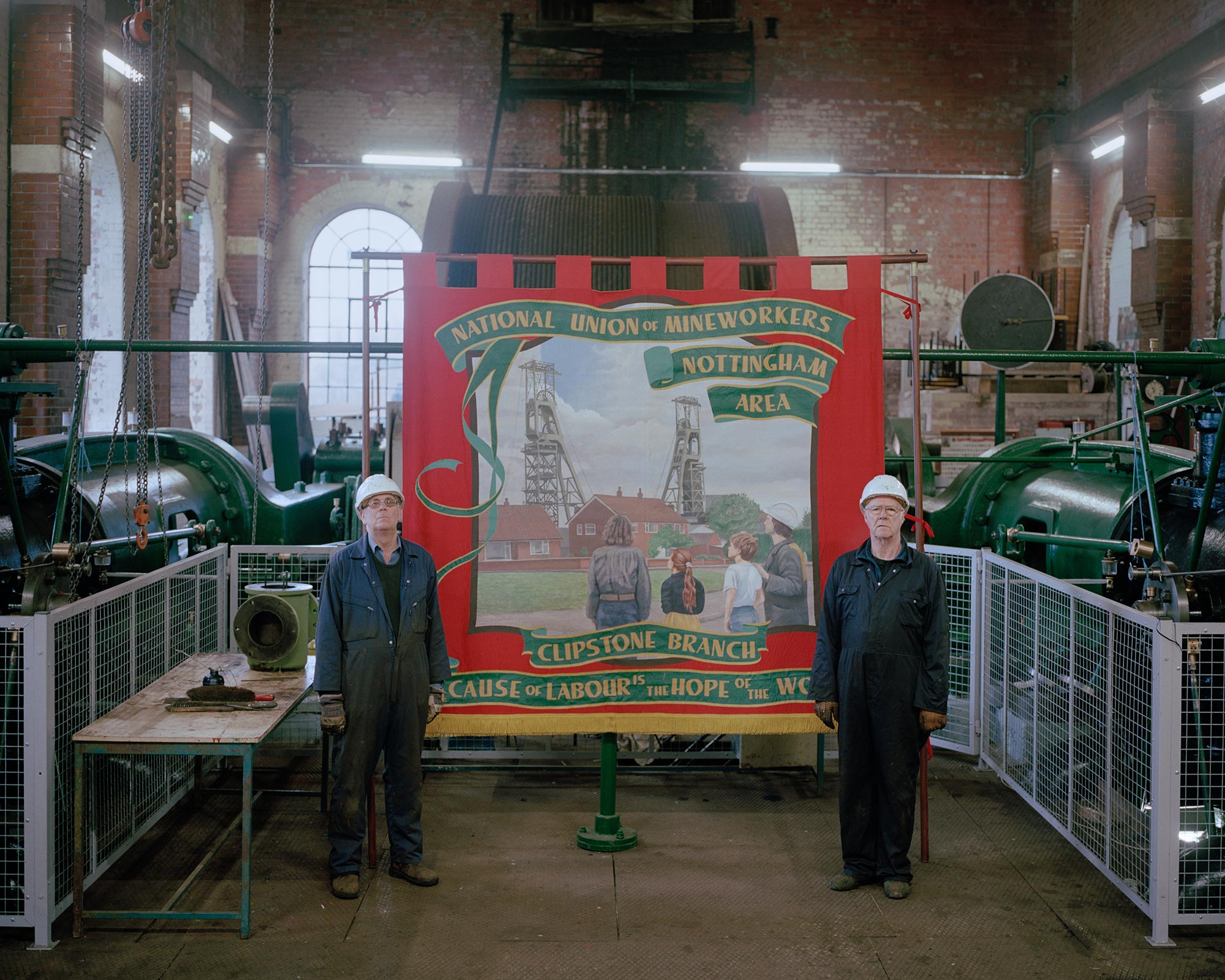 Volunteers at the restored Pleasley Colliery, posing with the National Union of Mineworkers Clipstone Branch banner.