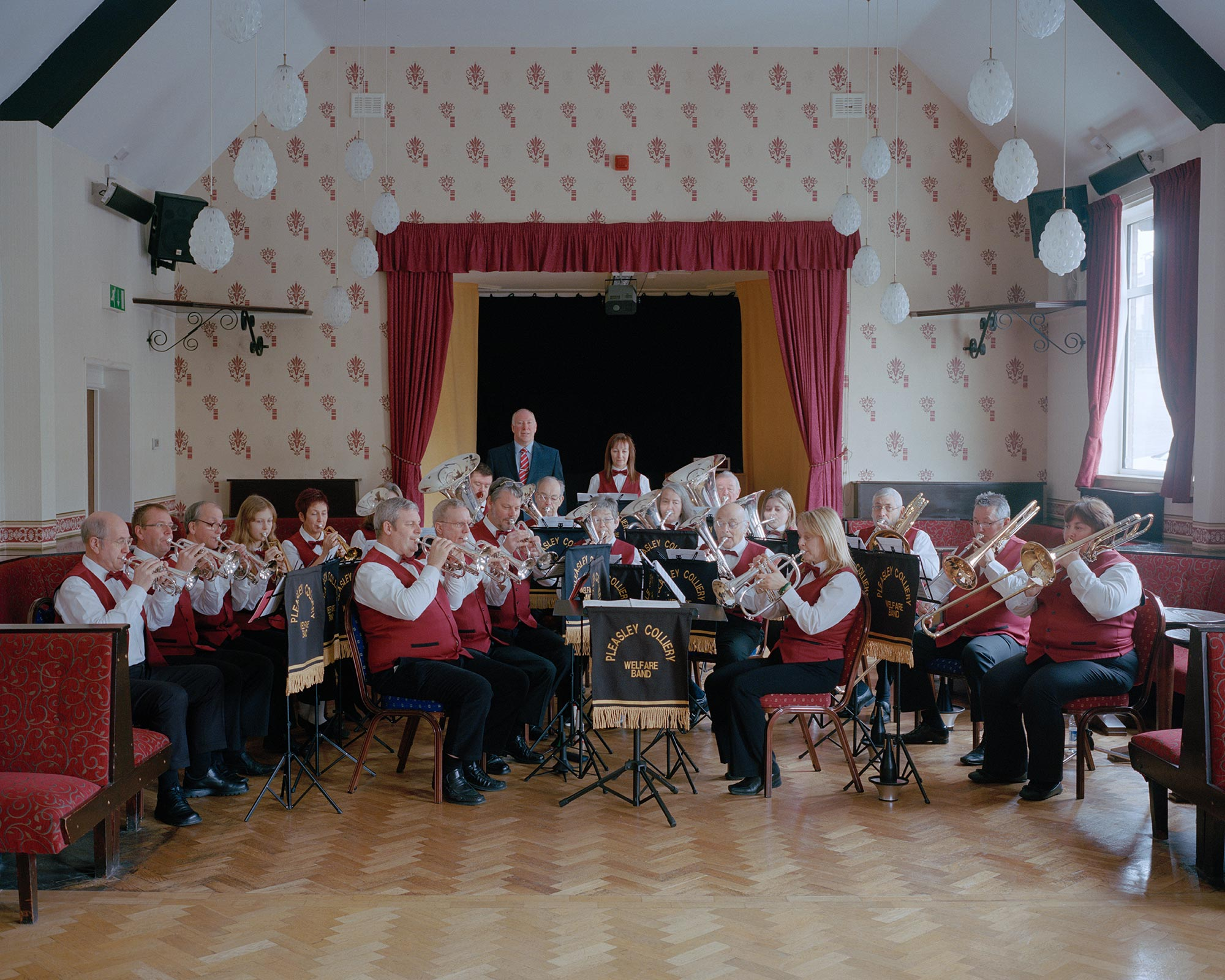 Pleasley Colliery Brass Band rehearsing at Pleasley Miners' Welfare, Derbyshire.