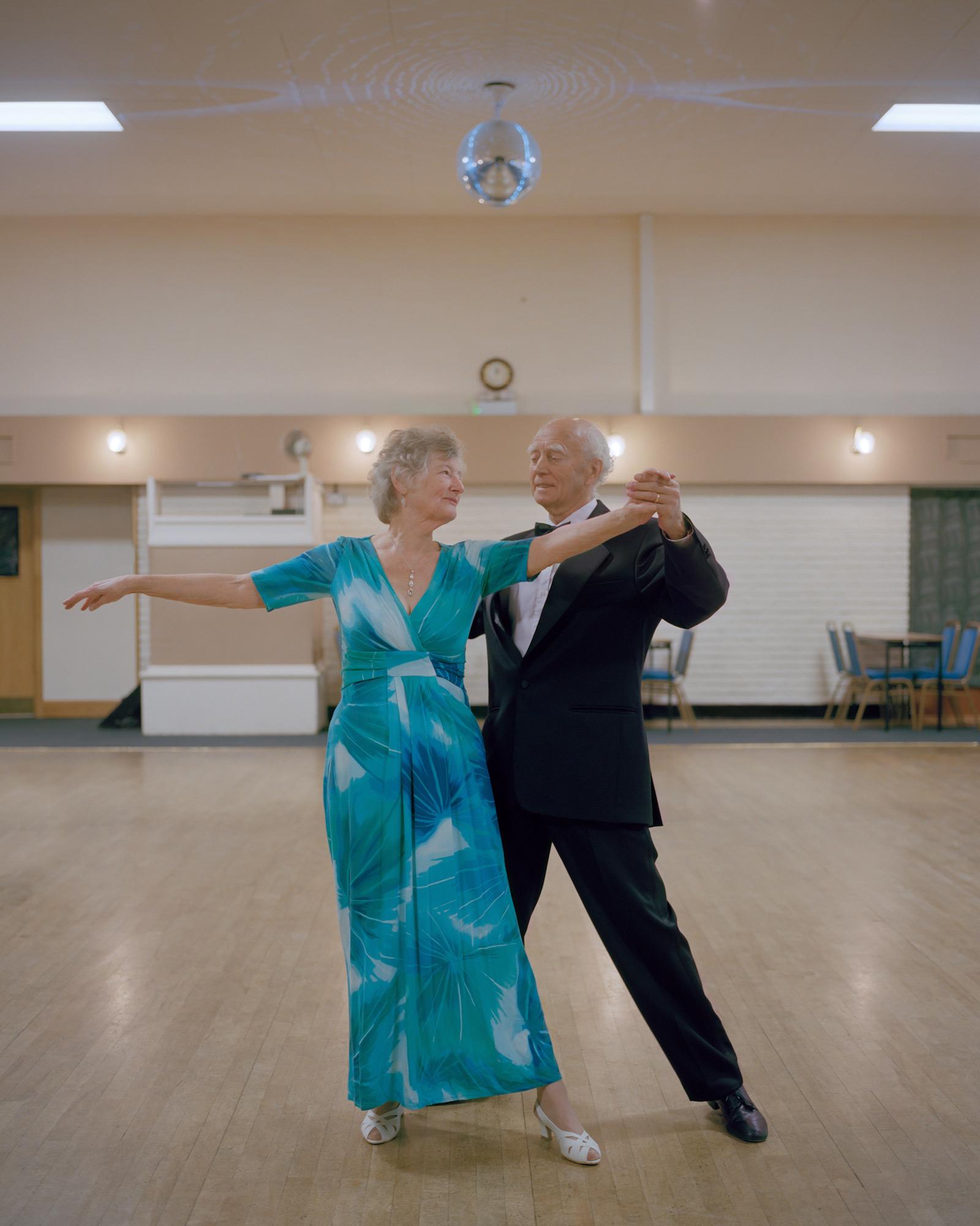 Bill, an ex-miner, with his partner Pauline attending their Ballroom Dancing class, Forest Town Miners' Welfare, Nottinghamshire.
