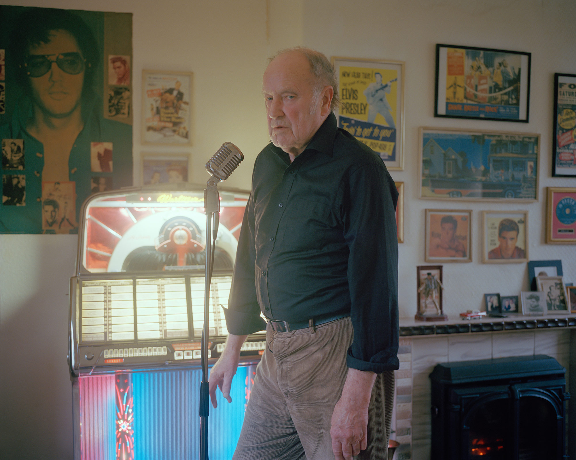 Stephen, an ex-miner and Elvis Presley fanatic, at home with his 1950's jukebox.