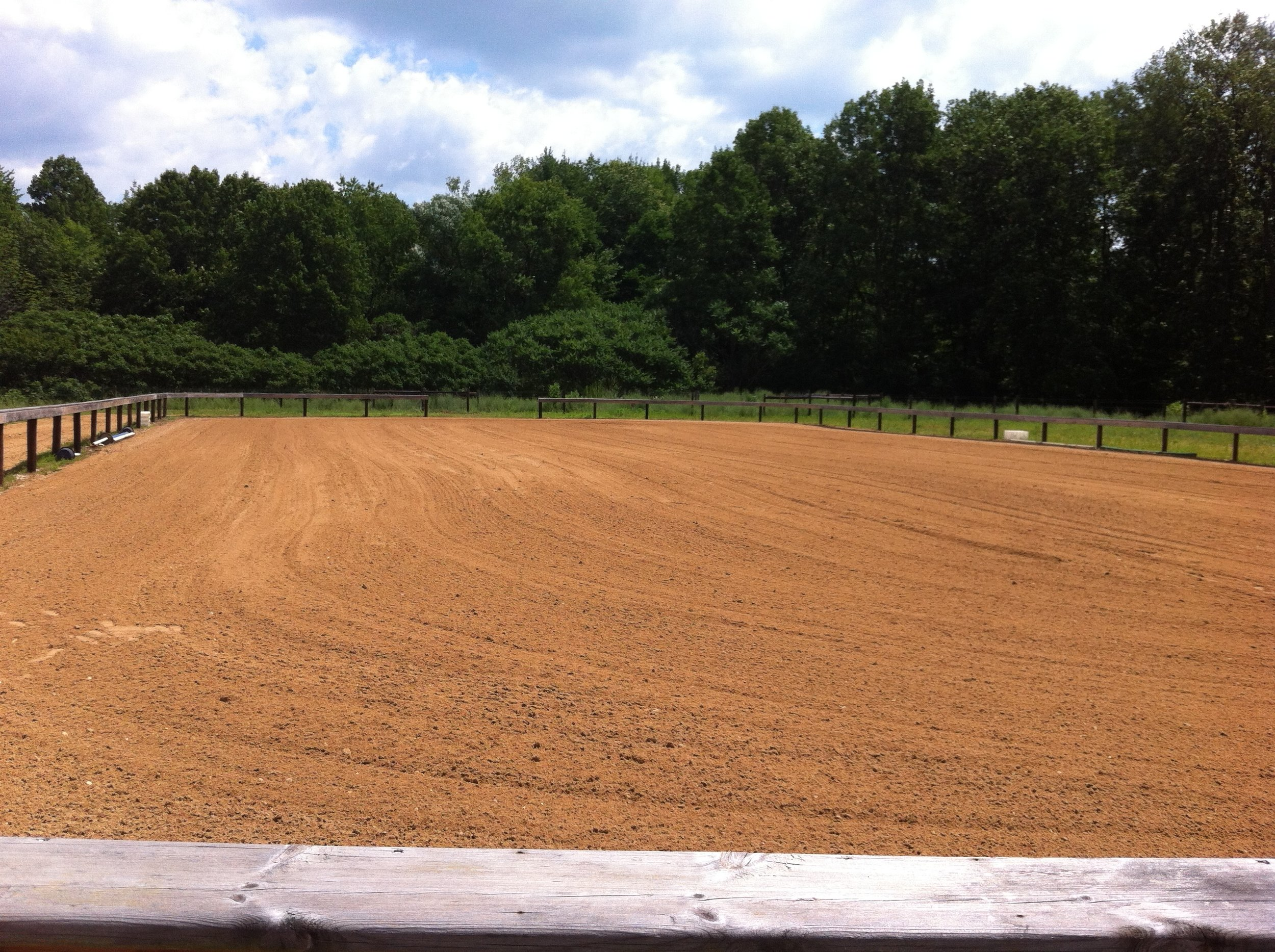 80x100 outdoor arena with limited bleacher seating