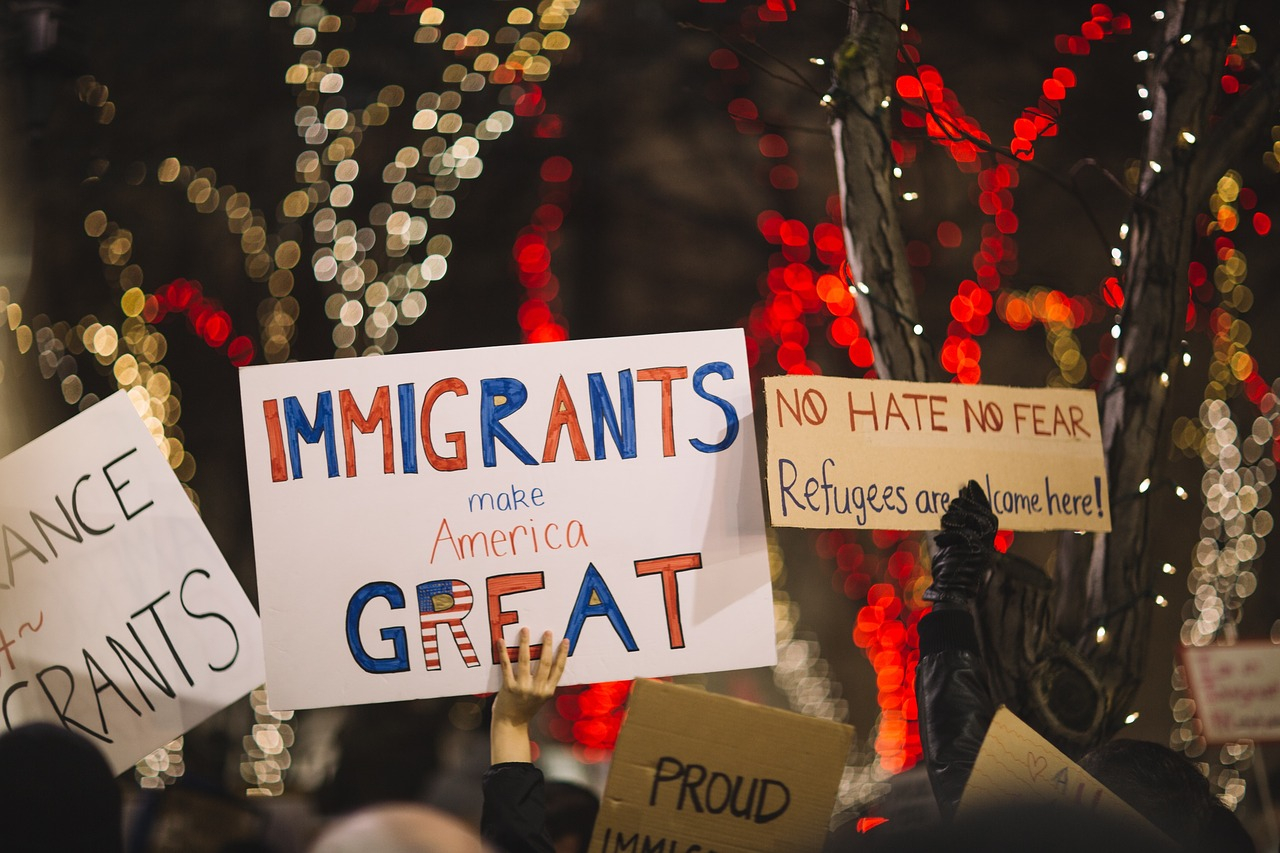 People-Us-Protest-Posters-Immigrants-Rally-2590766.jpg