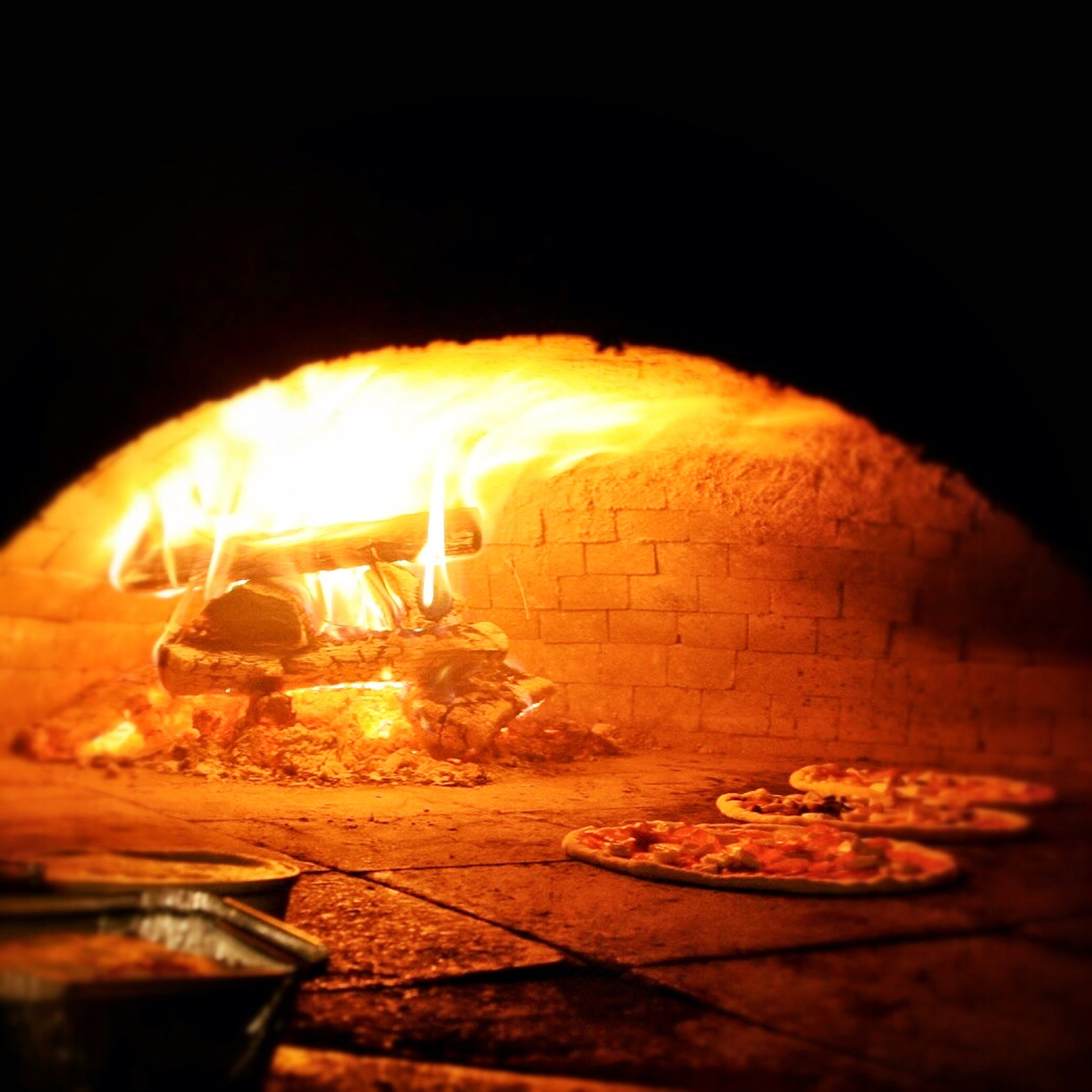 Wood Burning Oven with Pizza Cooking on the Hearth
