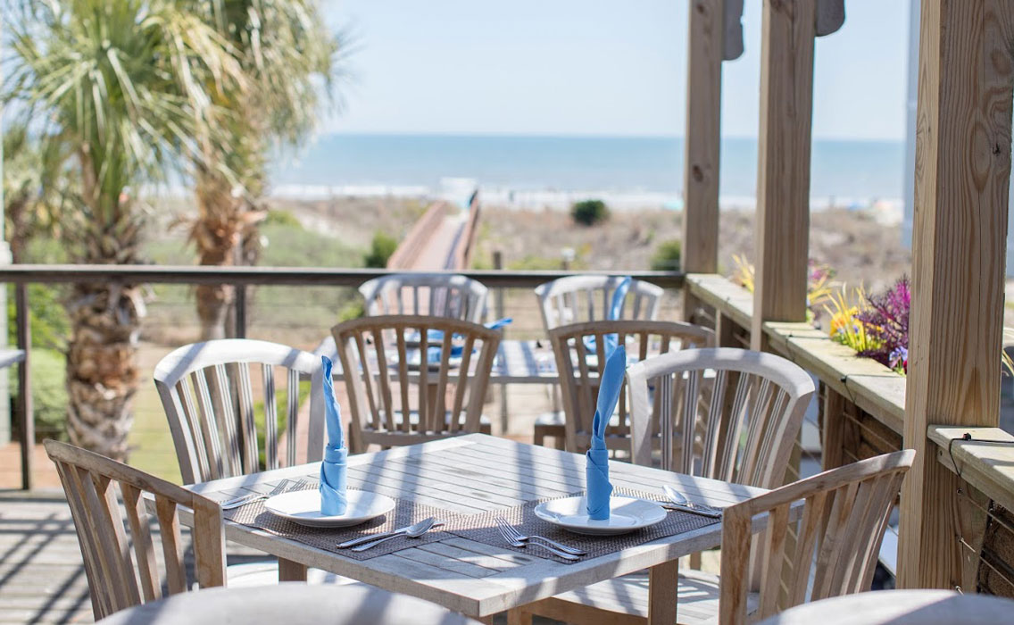 Share the Fritto Misto seafood platter at   Coda del Pesce   on a full-moon night on the front beach of Isle of Palms.