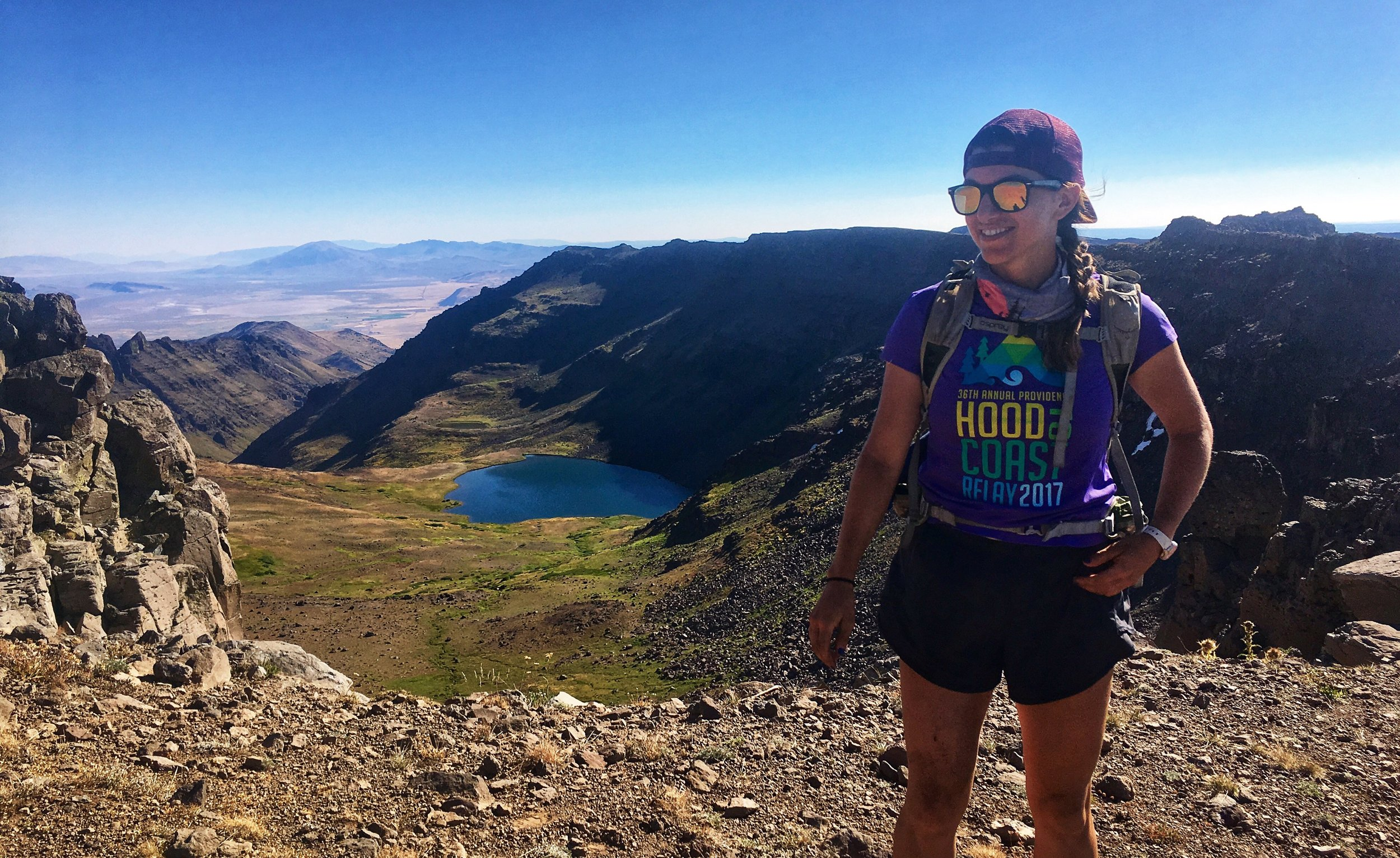 Emily Estrada - Whether she's running on a mountain, riding a bike, playing ultimate frisbee, or clipped in and ready to climb, you can be sure of two things: Emily is a warrior and she's wearing a smile! Her spirit animal is a badger,
