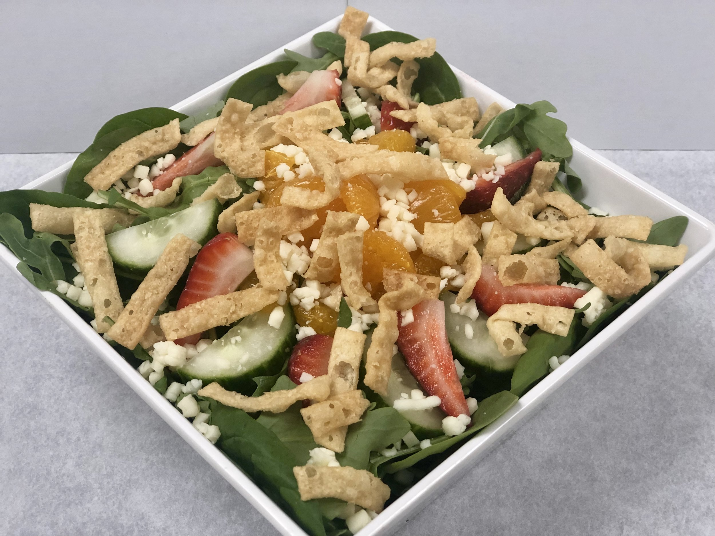 Summer Salad   Strawberries, mandarin oranges, mozzarella cheese, cucumbers, and won-ton strips over a bed of spinach and arugula.   Small: 8.99 Large: 10.99