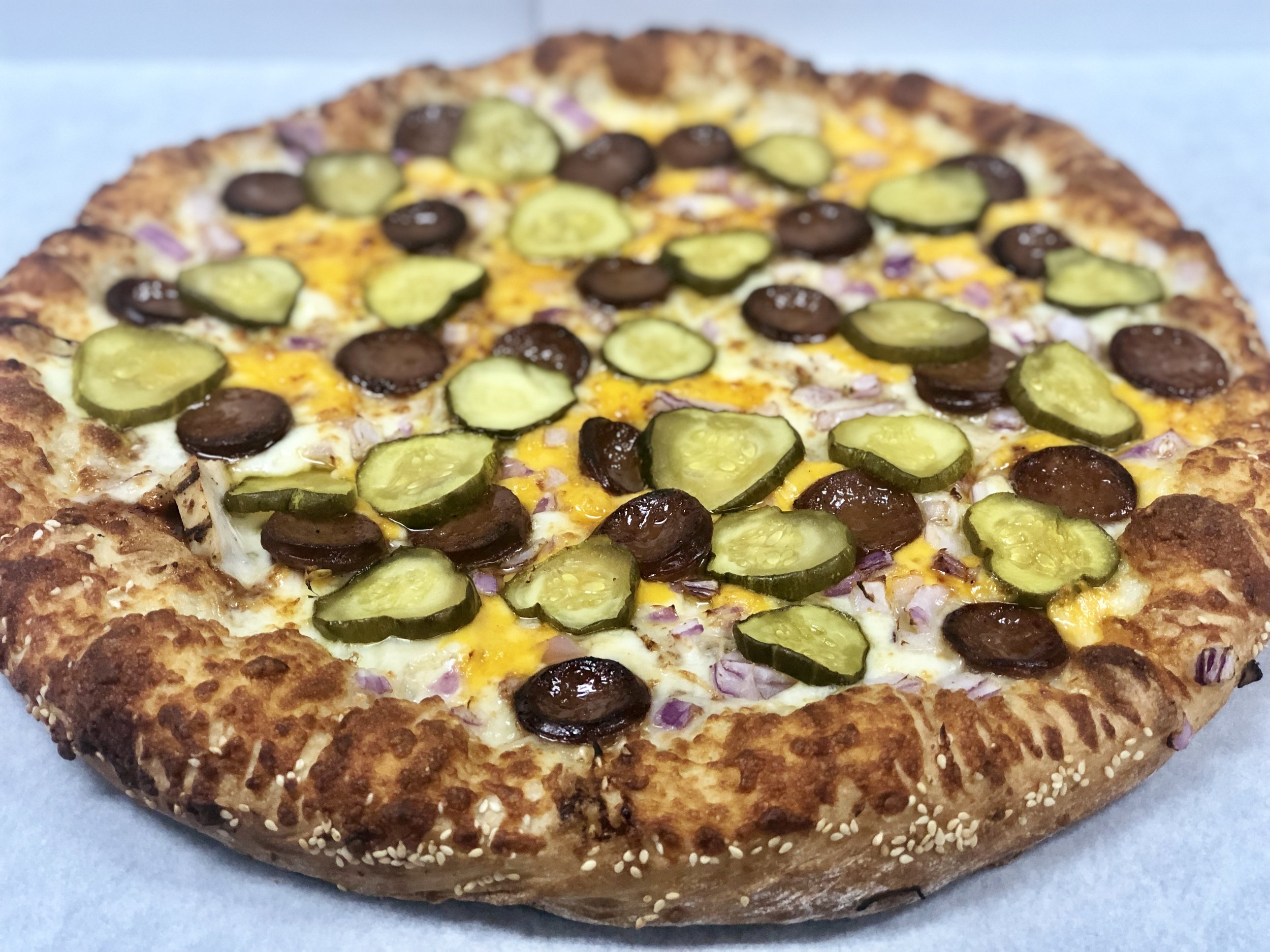 BBQ Picnic Pizza   BBQ sauce, BBQ sausage, chicken, cheddar and mozzarella cheeses, onions, sweet-hotties pickles, and a sesame seed crust.   Small Medium Large X-Large    $15.93 $19.18 $22.13 $24.44   For more information on our BBQ Sausage from Little town Jerky, click   HERE.