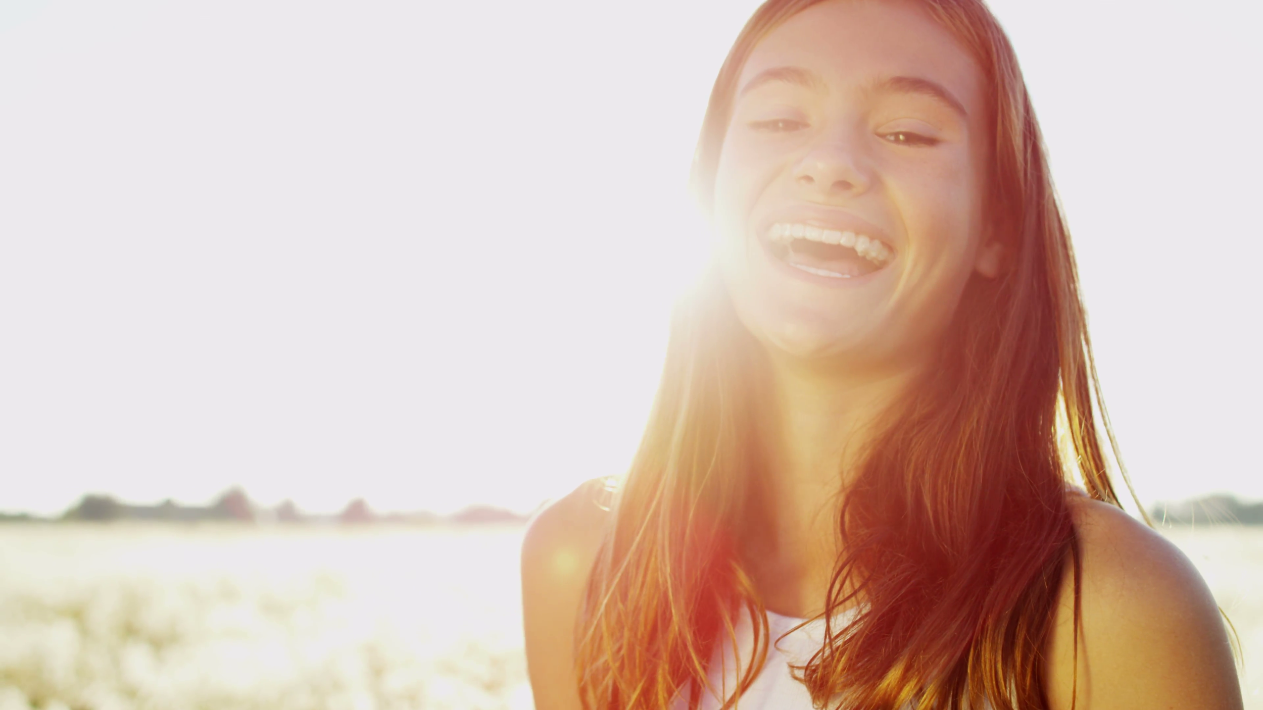 portrait-happy-smiling-young-pretty-girl-outdoors-summer-sunshine-sun-flare_ejxtgist__F0000.png