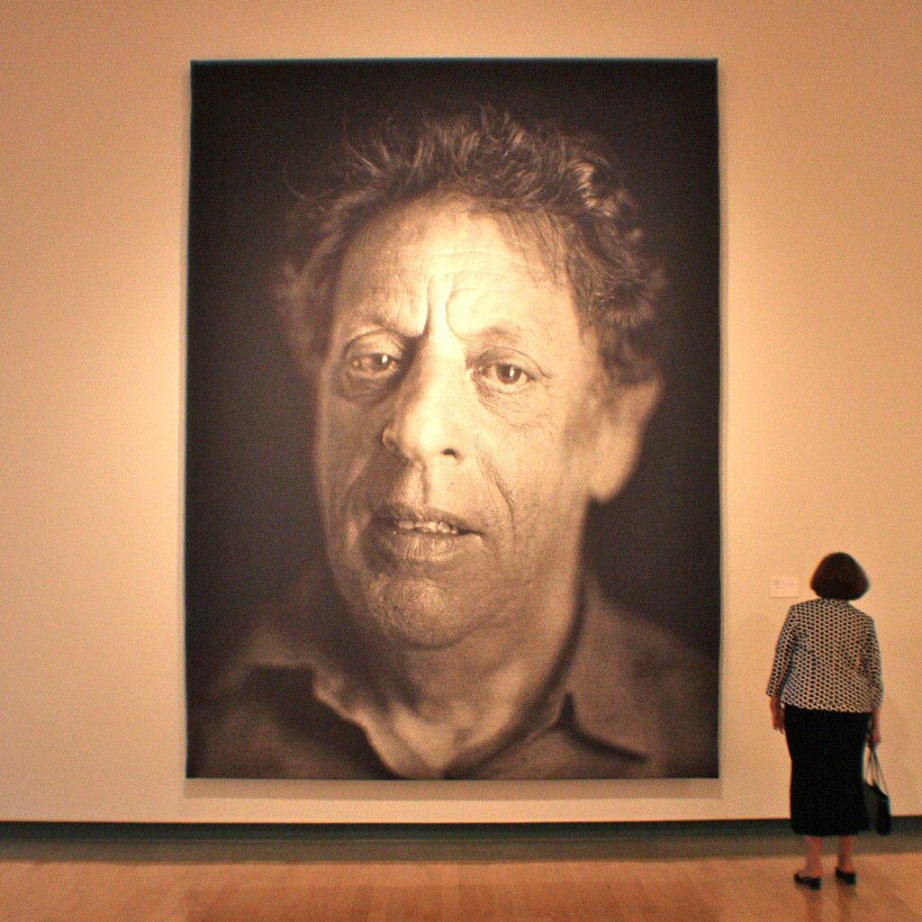 "Charles Thomas ""Chuck"" Close is an American painter, artist and photographer. He makes massive-scale photo-realistic portraits. Wikimedia."