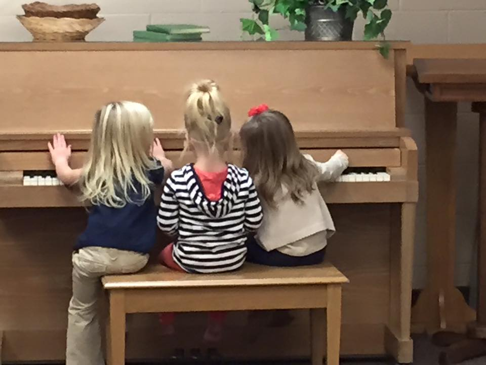 Girls Playing Piano