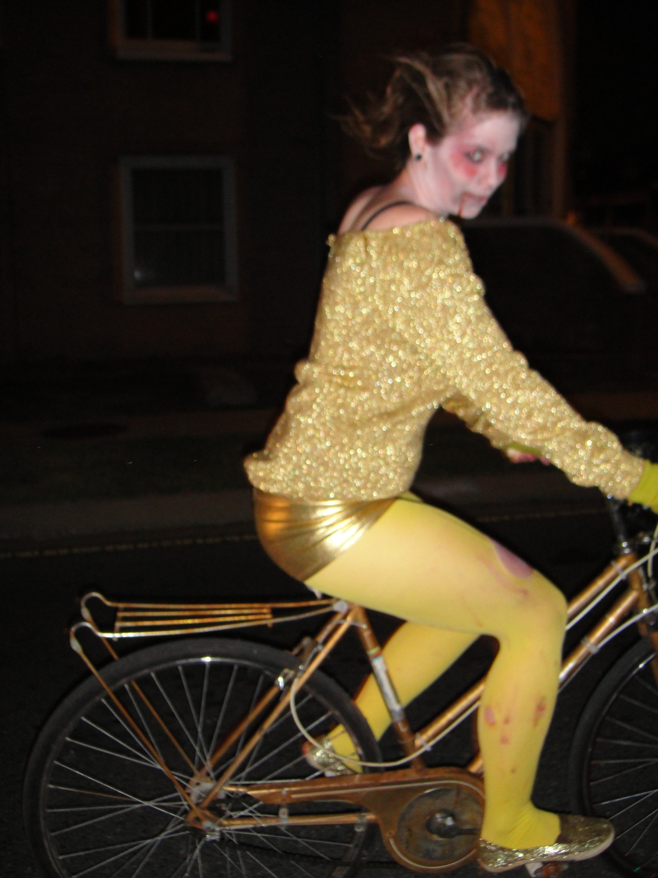 A golden zombie on a golden bike... it's worth the blurry photo!