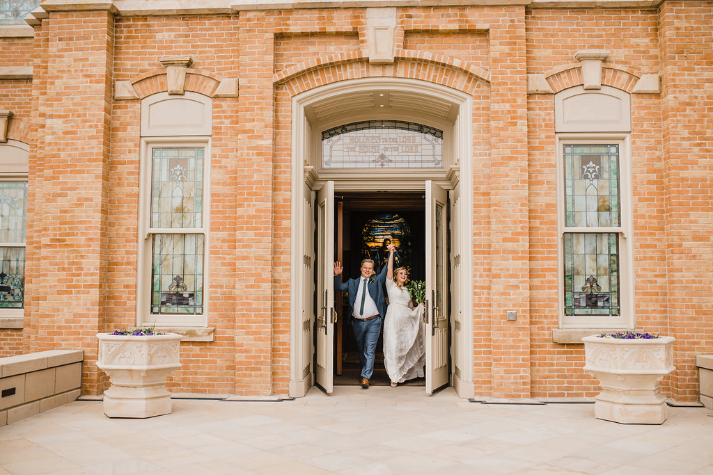 wedding photographer captures couple leaving the provo city center temple wedding photography