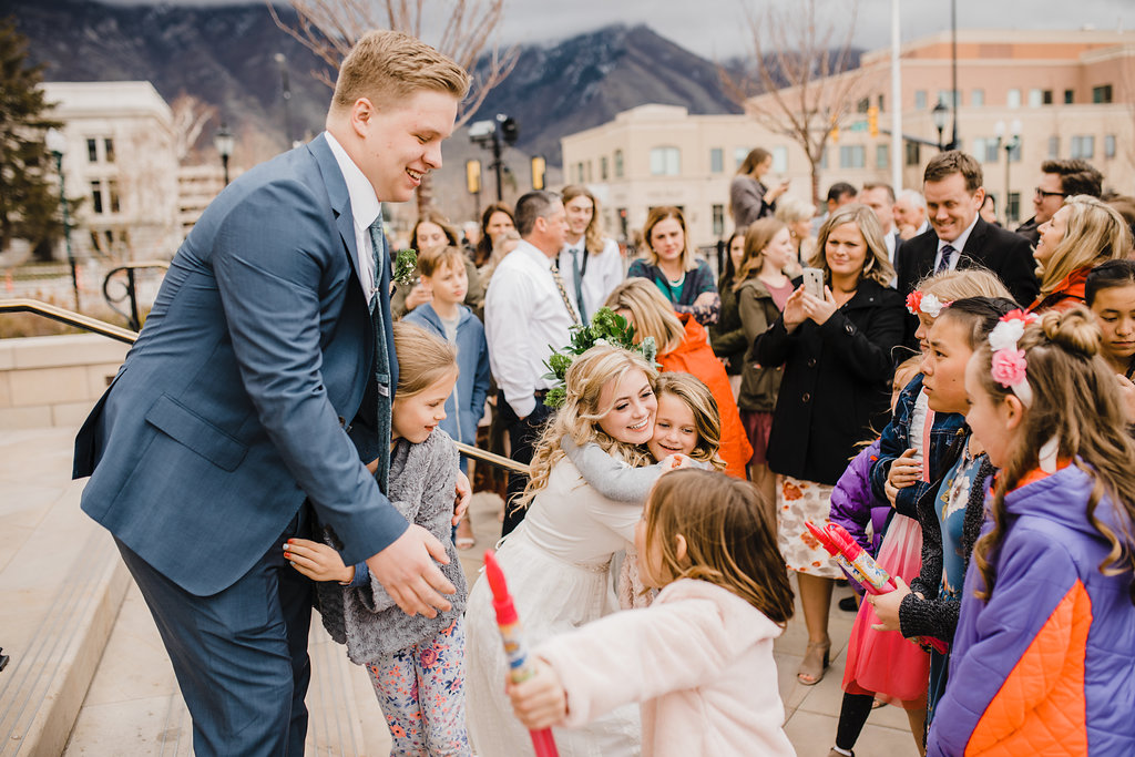 sweet greeting with family wedding photographer provo city center temple