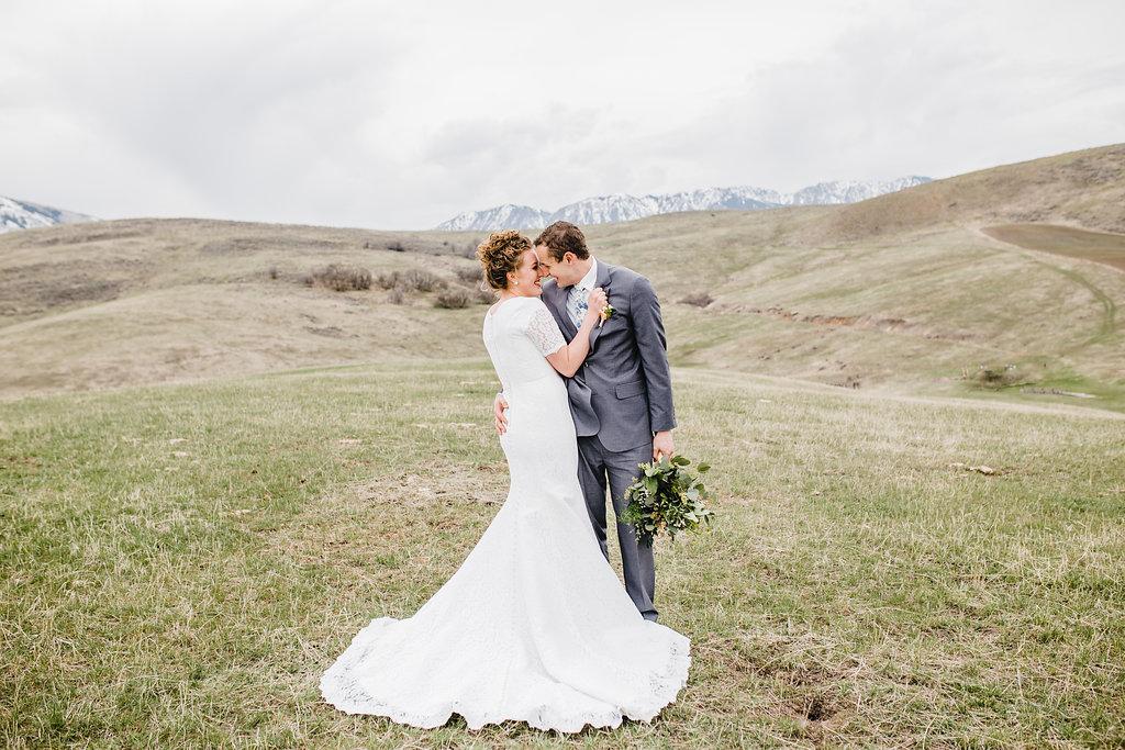 bride and groom in love outdoor mountains formals wedding photographer logan ut