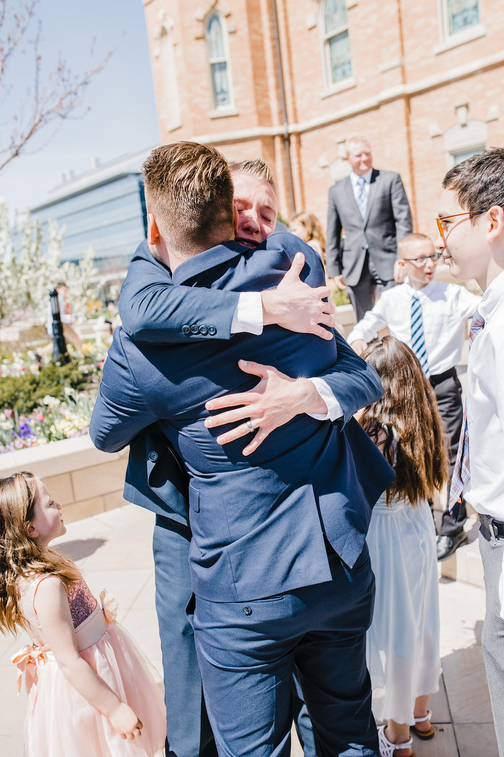family hugs after temple exit lds wedding photographer logan utah calli richards