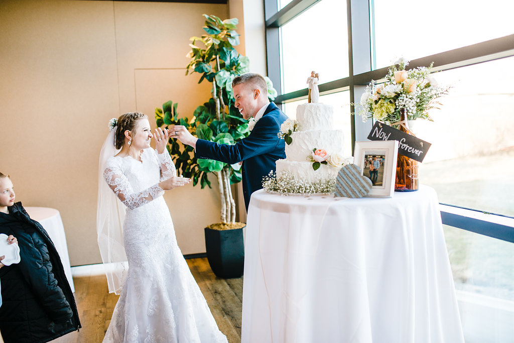 wedding photographer provo utah reception pictures cake sharing