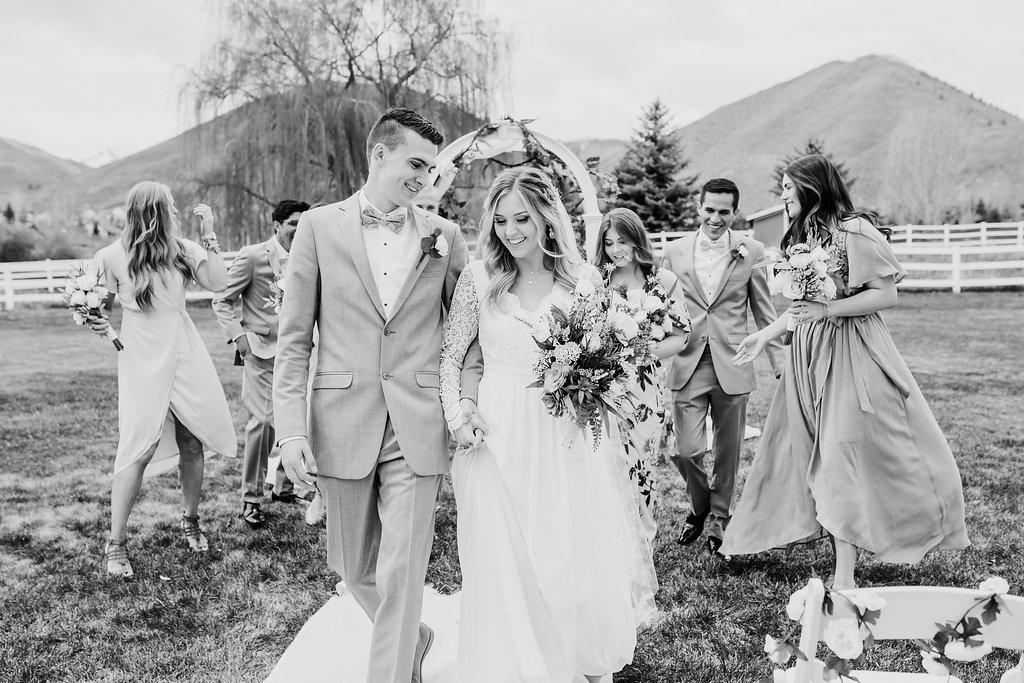 black and white walking down the aisle wedding photographer calli richards wedding ceremony photography park city utah